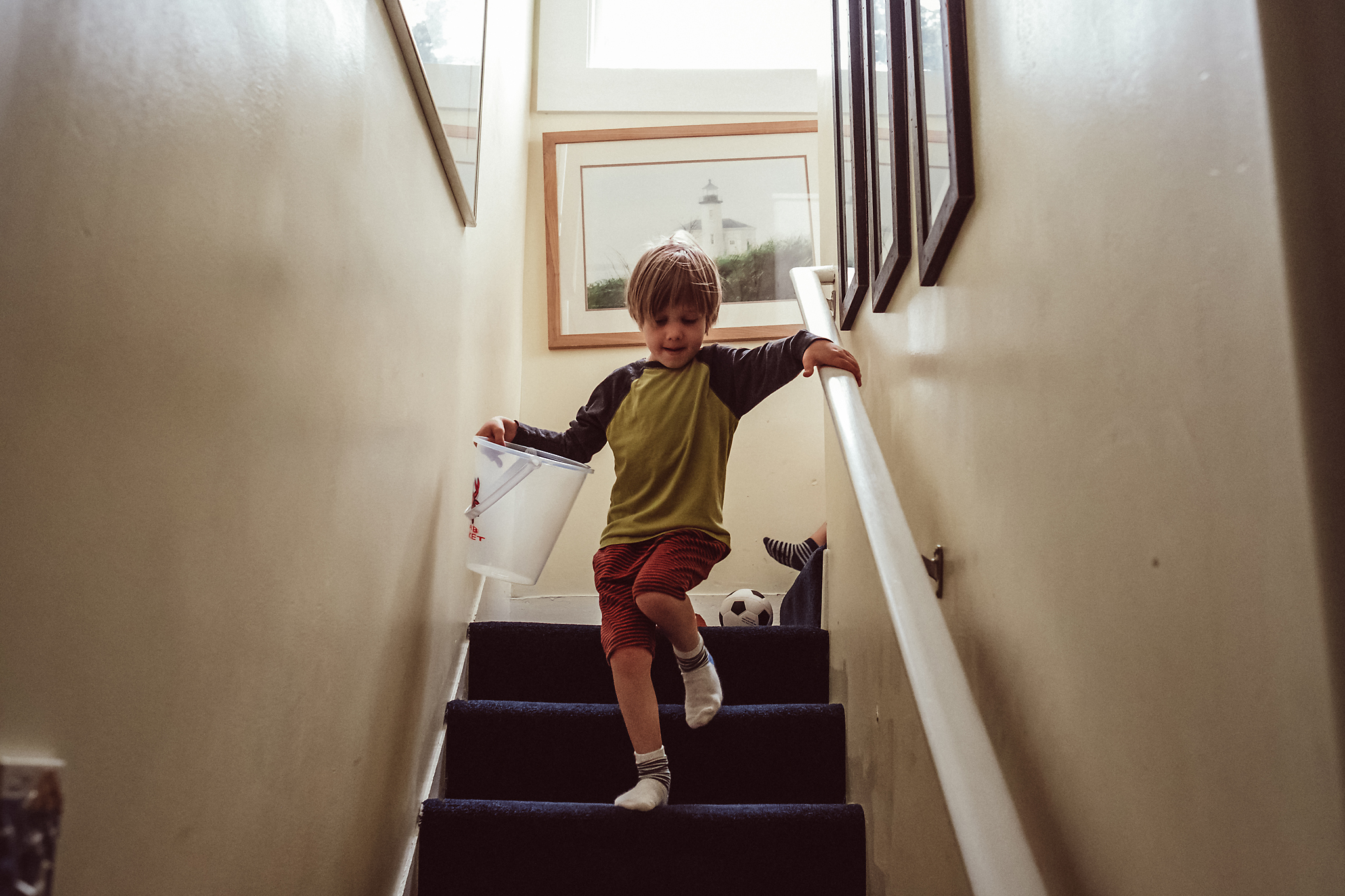 Boy walks down stairs