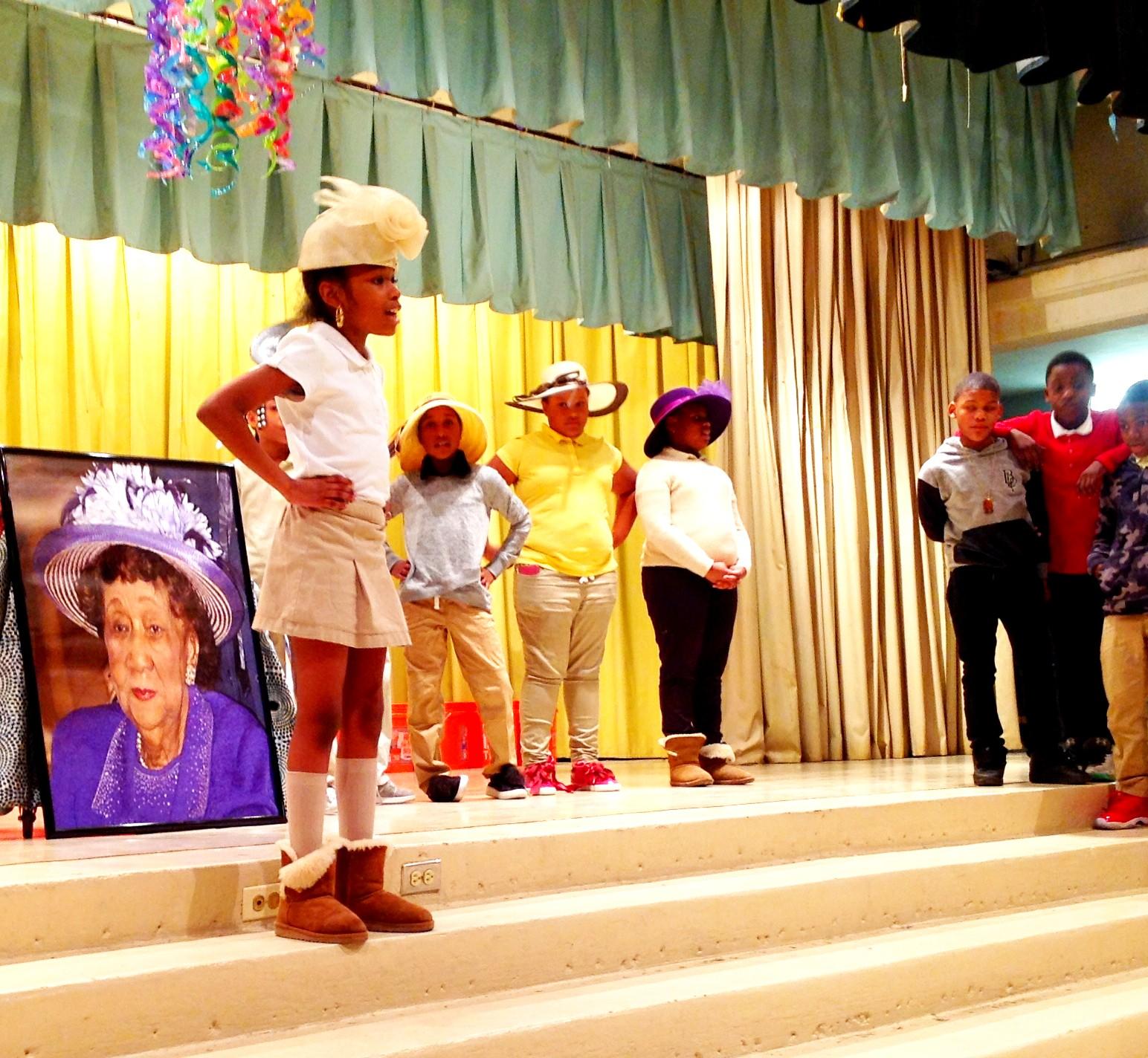 Lady scholars wear hats donated by Mama Deborah Pierce-Fakunle and the St. Paul Baptist Church.