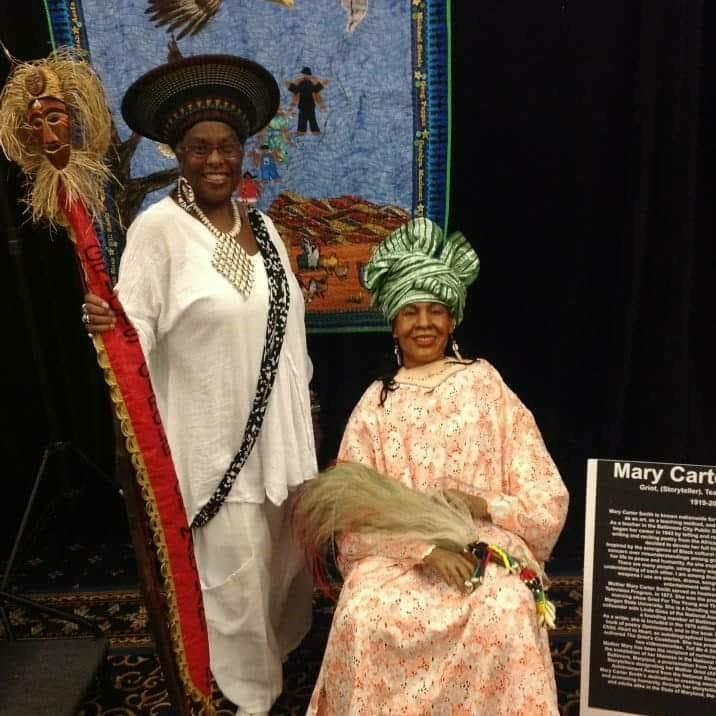 Ms. Deborah Fakunle with the wax figure of Queen Mary Carter Smith