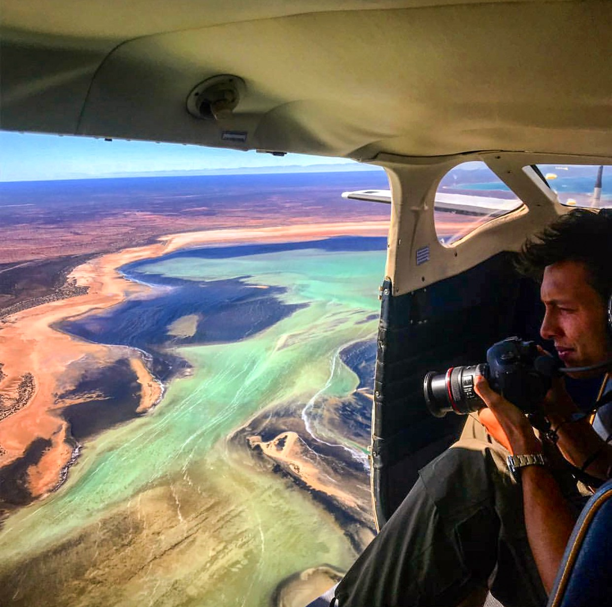 Steven Manolakis flying over the Shark Bay World Heritage Area, Western Australia. Photo by Shark Bay Aviation.