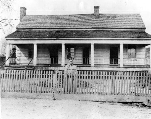 [A woman standing outside the Dawsey/Davis/Bates home c. 1900- Photo Courtesy and Property of the  State Archive of Florida ]