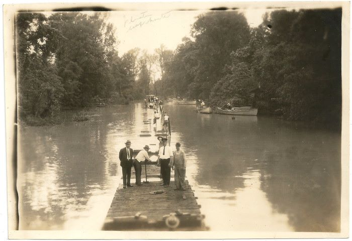 Men atop train cars during the 1927 flood in Rodney