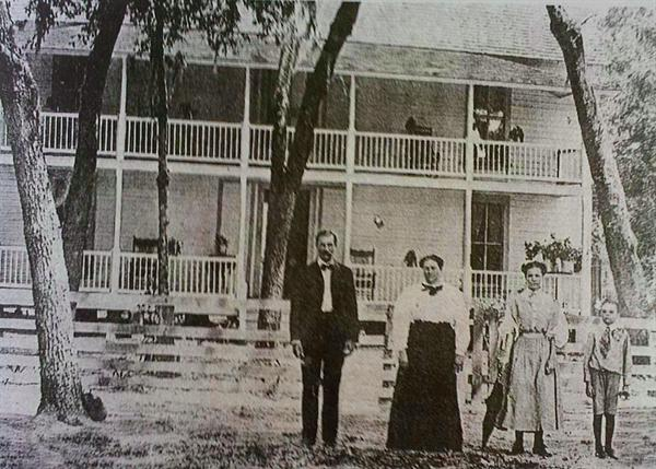 The Lyman Lee Family standing in front of their boarding house