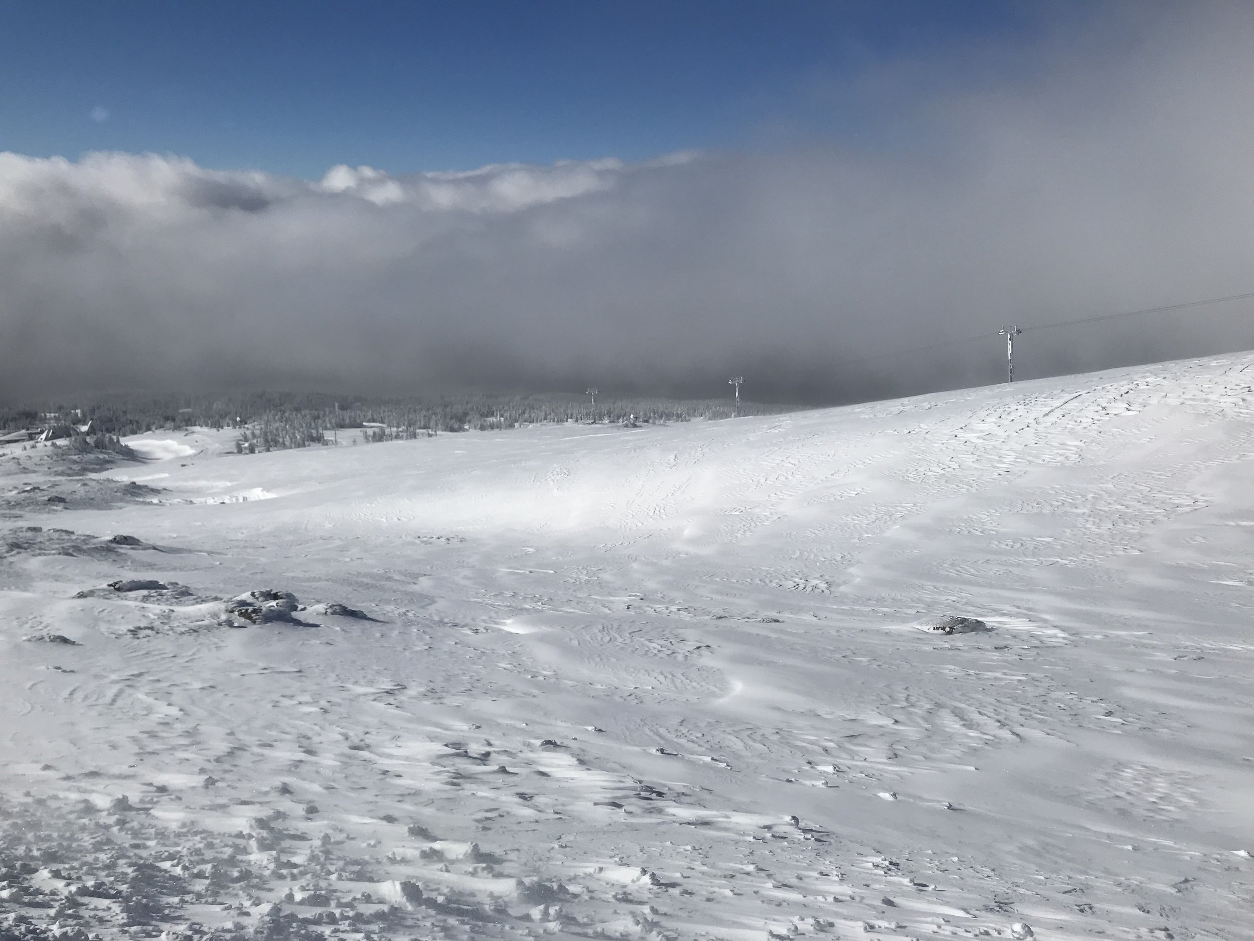 """Another look down the mountain from the """"front porch"""" of the Silcox...this time the sun has come up a bit more and we were getting ready to depart on skis and boards. You can see Timberline Lodge down in the distance. Image Courtesy: Dan Meyers"""