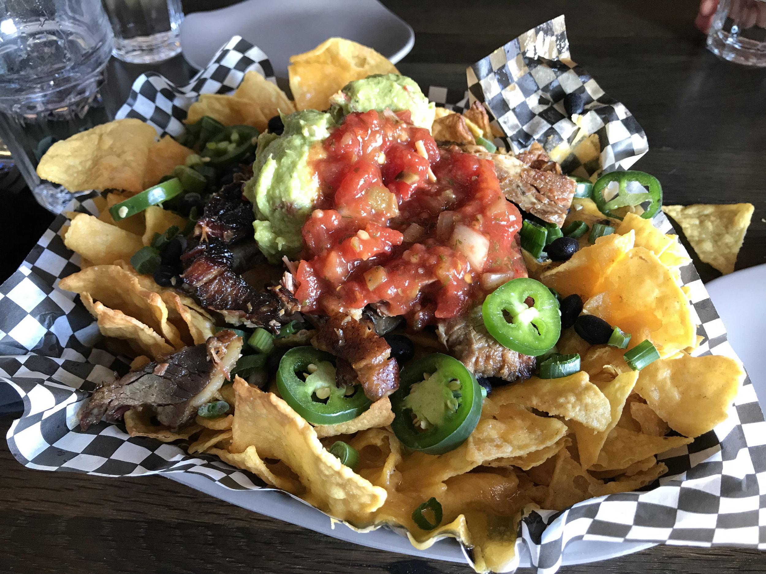 """This heaping nacho plate from the  """"Y Bar""""  (in the Day Lodge at Timberline)was just the thing to recharge three of us for the rush back out to """"find more un-tracked"""" and close out the day. Epic indeed. Image Courtesy: Dan Meyers"""