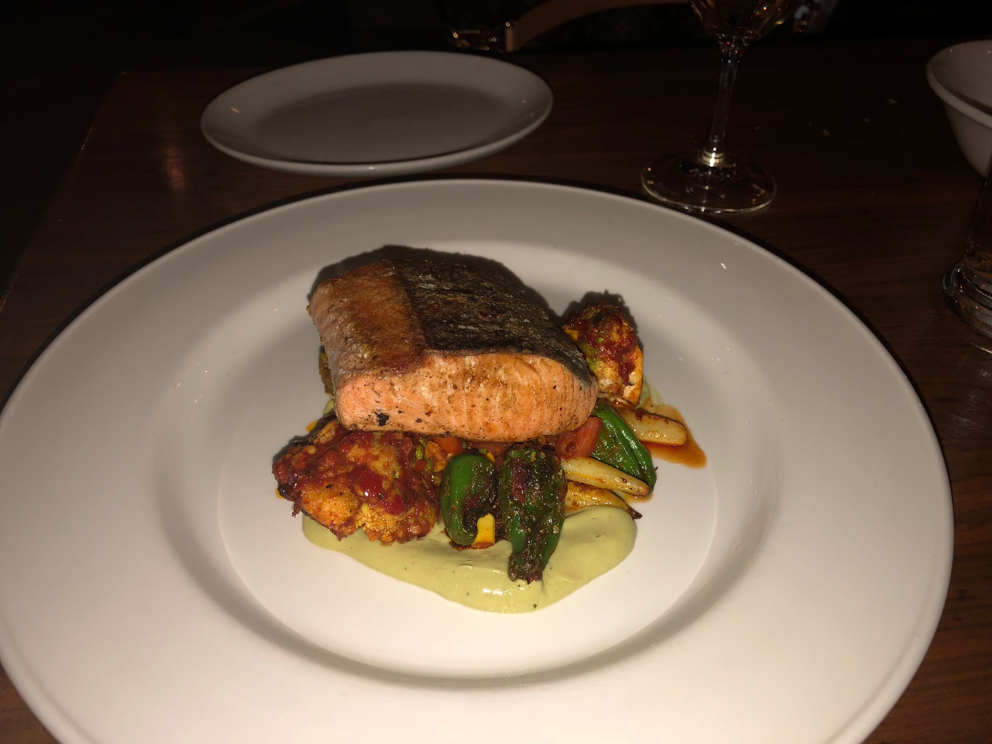 Here's a pic of my wife's order…the Wild King Salmon a la Plancha with harissa, summer succotash, creamy poblano puree. Yum! Image Credit: Dan Meyers