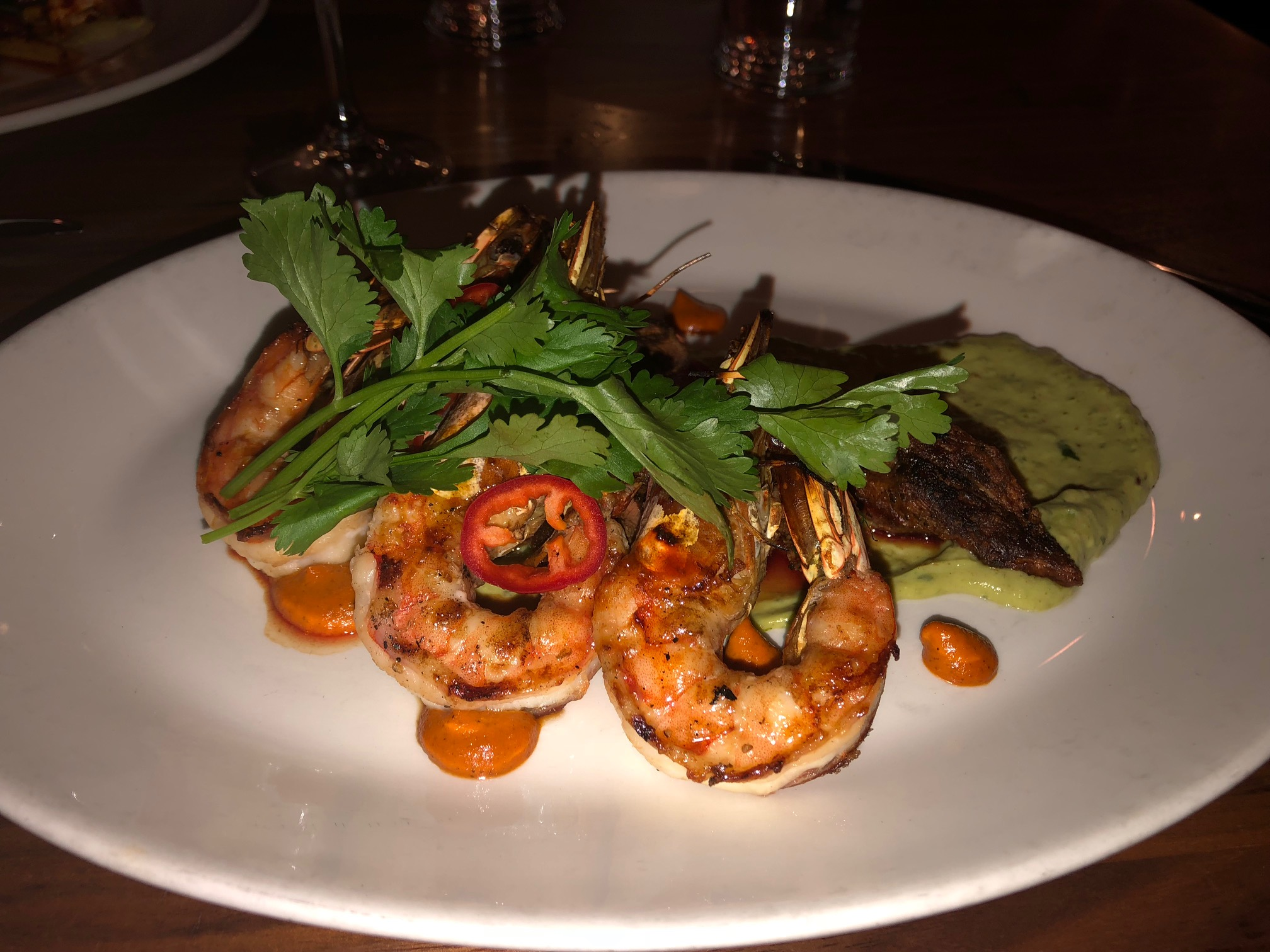 Here is my entree, the Brandt Beef Flat Iron Surf & Turf with Kauai prawns, avocado puree, piquillo salsa (GF). Needless to say, I was quite happy with this selection. The steak was very nice and the prawns, well, I could have eaten 10 more! Image Credit: Dan Meyers