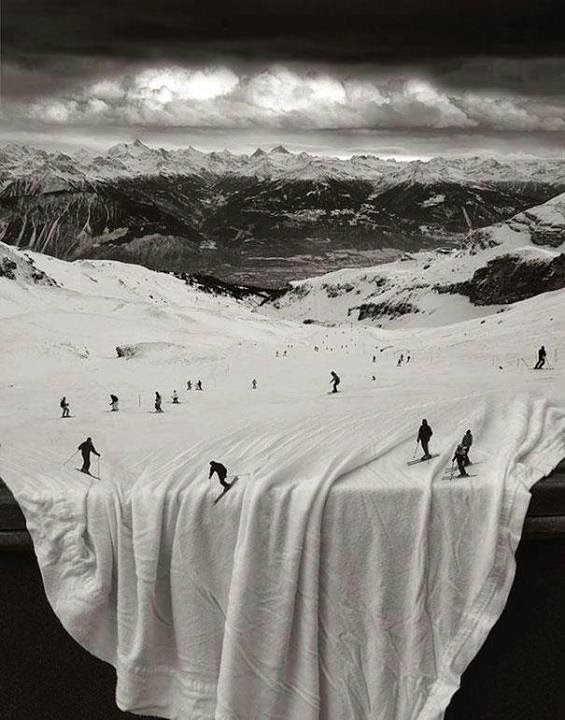 I just love this illusion. A big, photo mural, table with white table cloth, and I'm suspected some Photoshop work on the skiers. Too fun! Image Courtesy: mightyopticalillusions.com