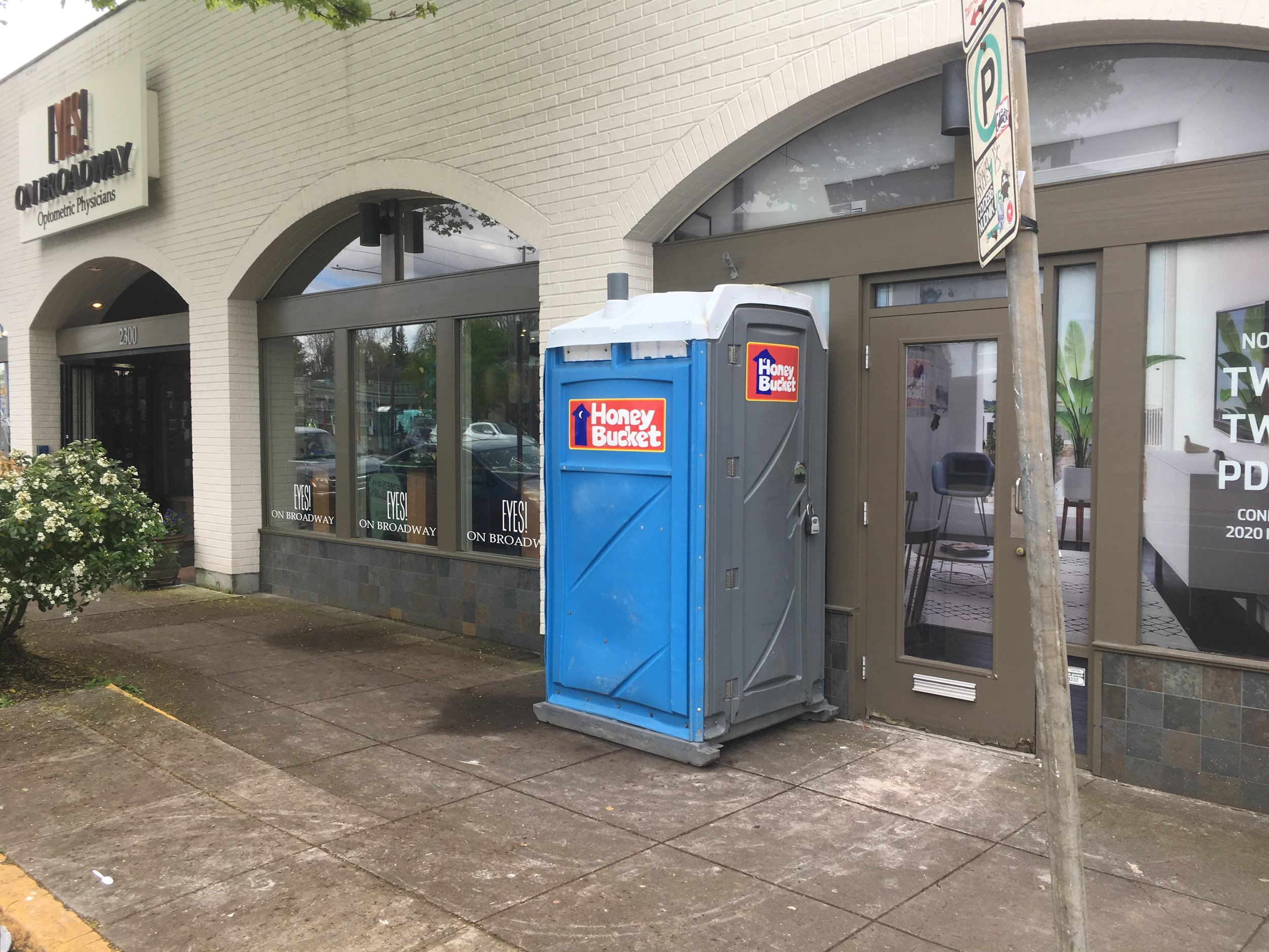 Success drives the need for more space…and Eyes on Broadway has been  voted the top eyewear shop in Portland for 4 years running . Of corse the Honey Bucket is only temporary! ;) Image Courtesy: EyesOnBroadway