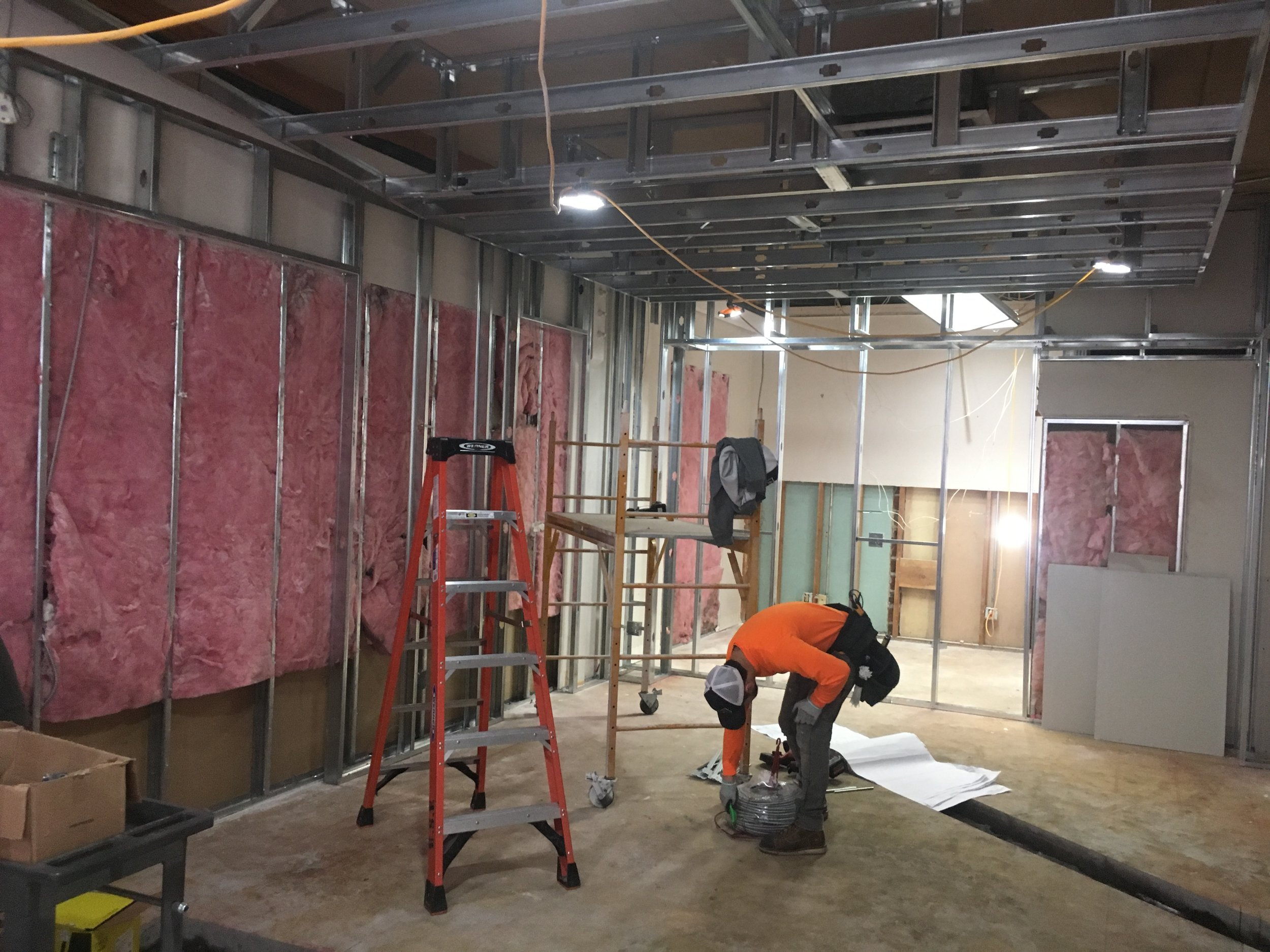 This view, looking into the space from what will be the expanded, front window area, shows the larger showroom and additional exam room entry. Image Courtesy: Eyes on Broadway