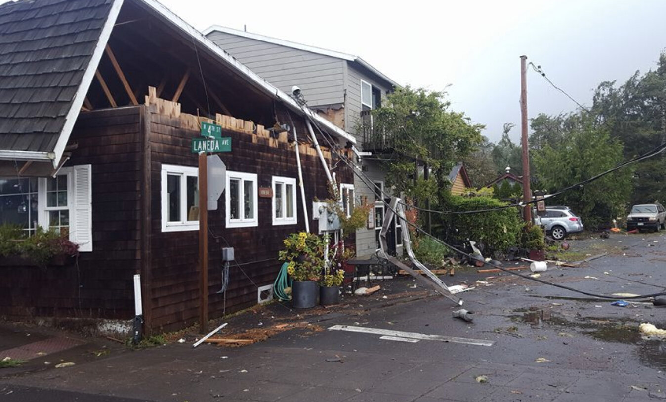 This picture, courtesy of The Tillamook Headlight Herald, shows damage along the main drag of Manzanita in 2016, following the touchdown of a tornado. Rare indeed and scary for the locals. Image Courtesy: Tillamook Headlight Herald