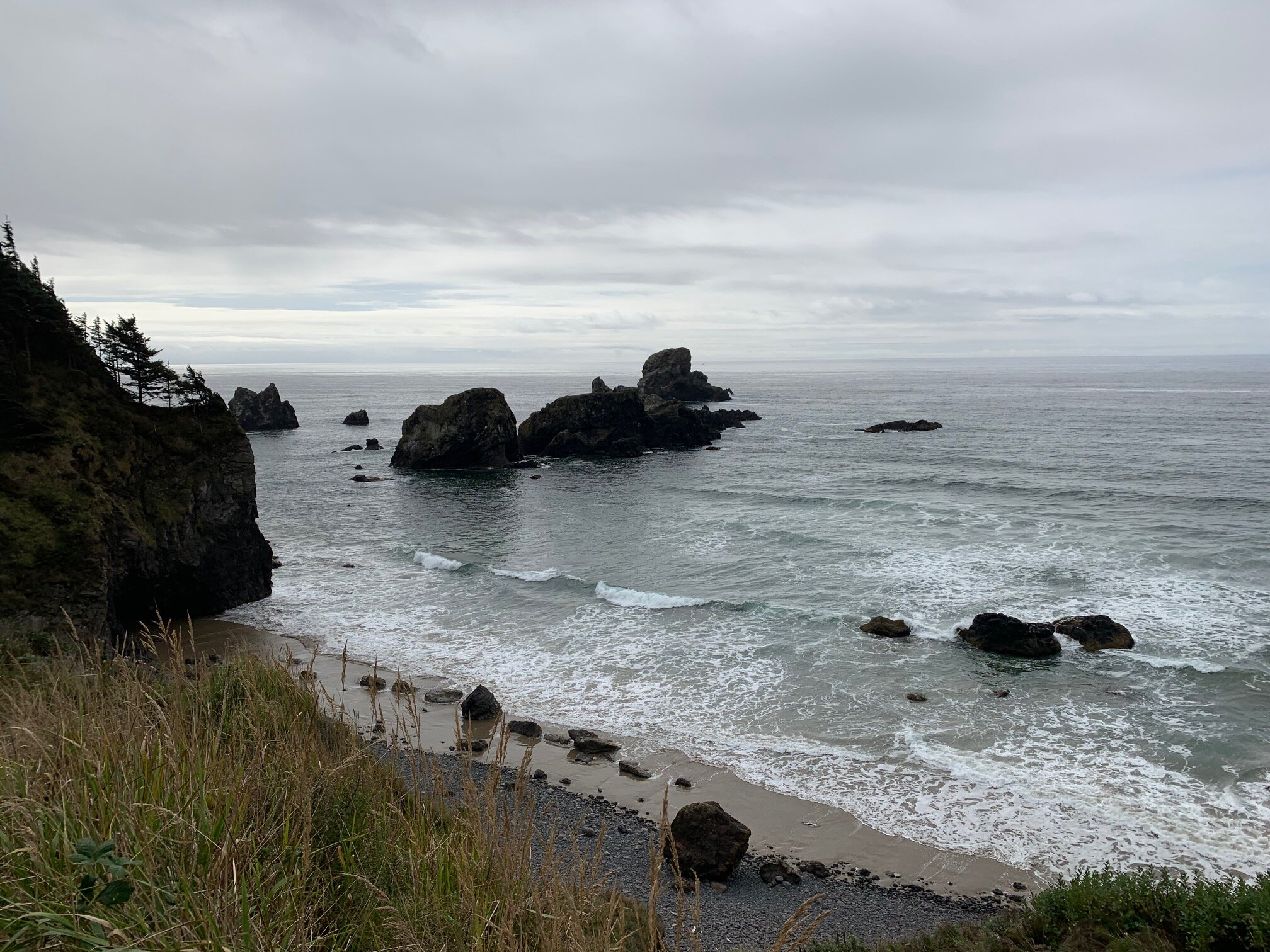 Hiking around nearby Ecola State Park is also incredible. This little beach was where the pirate ship emerged during the final scenes of  The Goonies . Other movies shot in and around this area include  Point Break  and  Kindergarten Cop .