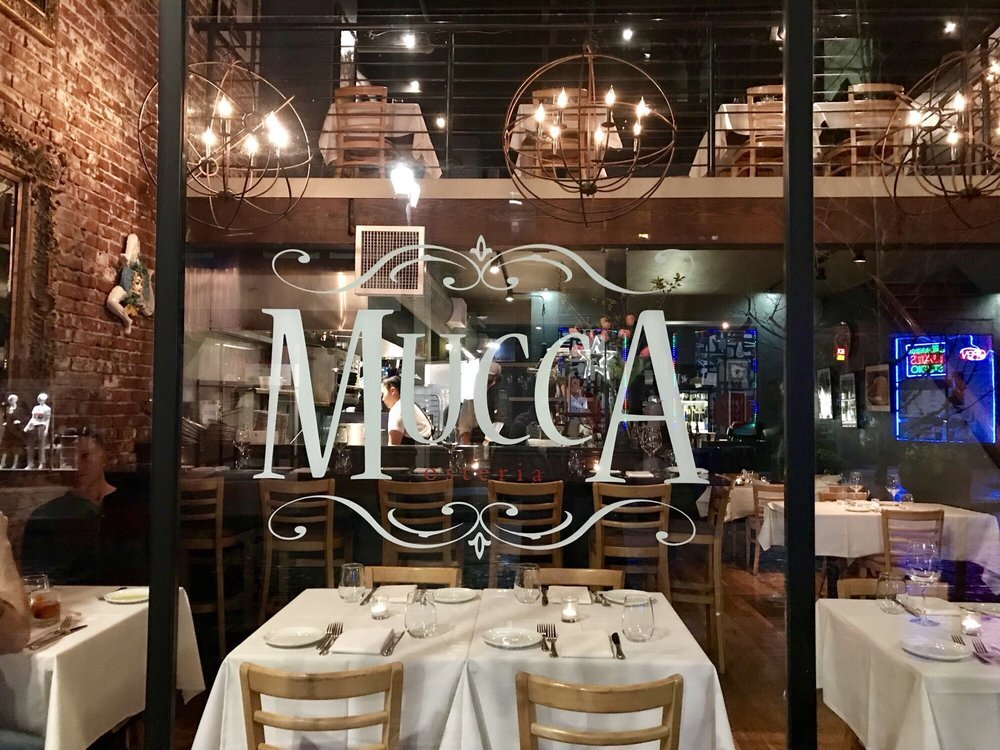 Mucca Osteria  is quaint inside with just a few tables upstairs and down. There is some bar seating as well. But get your reservations early…the word is out! Image Courtesy: Yelp.com