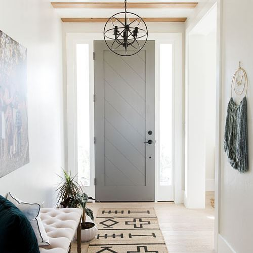 This foyer designed by @clearstonebuilders is fantastic! I love the subtle pattern on the door and the decorative beams on the ceiling. The runner is amazing too. Such a great space!  #interiordesign #interiordesigninspiration #interiordesigninspo #interiorinspiration #interiorinspo #design #designinspiration #designinspo #foyerdesign #foyerinspiration #foyerinspo #entrywaydesign #entrywayinspiration #entrywayinspo