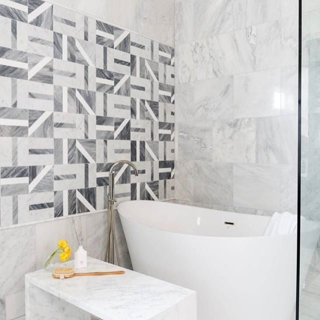 This bathroom designed by @laurauinteriordesign is incredible! I love the geometric tile on the wall. Such an interesting feature. I'm also crazy about the marble bench and the big, beautiful soaking tub. So luxurious!  #interiordesign #interiordesigninspiration #interiordesigninspo #interiorinspiration #interiorinspo #design #designinspiration #designinspo #bathroomdesign #bathroominspiration #bathroominspo #bathroomsofinstagram #bathroomsofinsta
