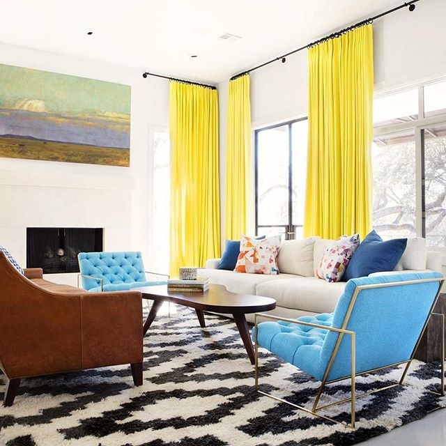 This living room designed by @sarahwittenbraker is amazing! I love the bright yellow curtains and the vibrant blue chairs along with all the fun patterns. Wonderful space!  #interiordesign #interiordesigninspiration #interiordesigninspo #interiorinspiration #interiorinspo #design #designinspiration #designinspo #livingroomdesign #livingroominspiration #livingroominspo