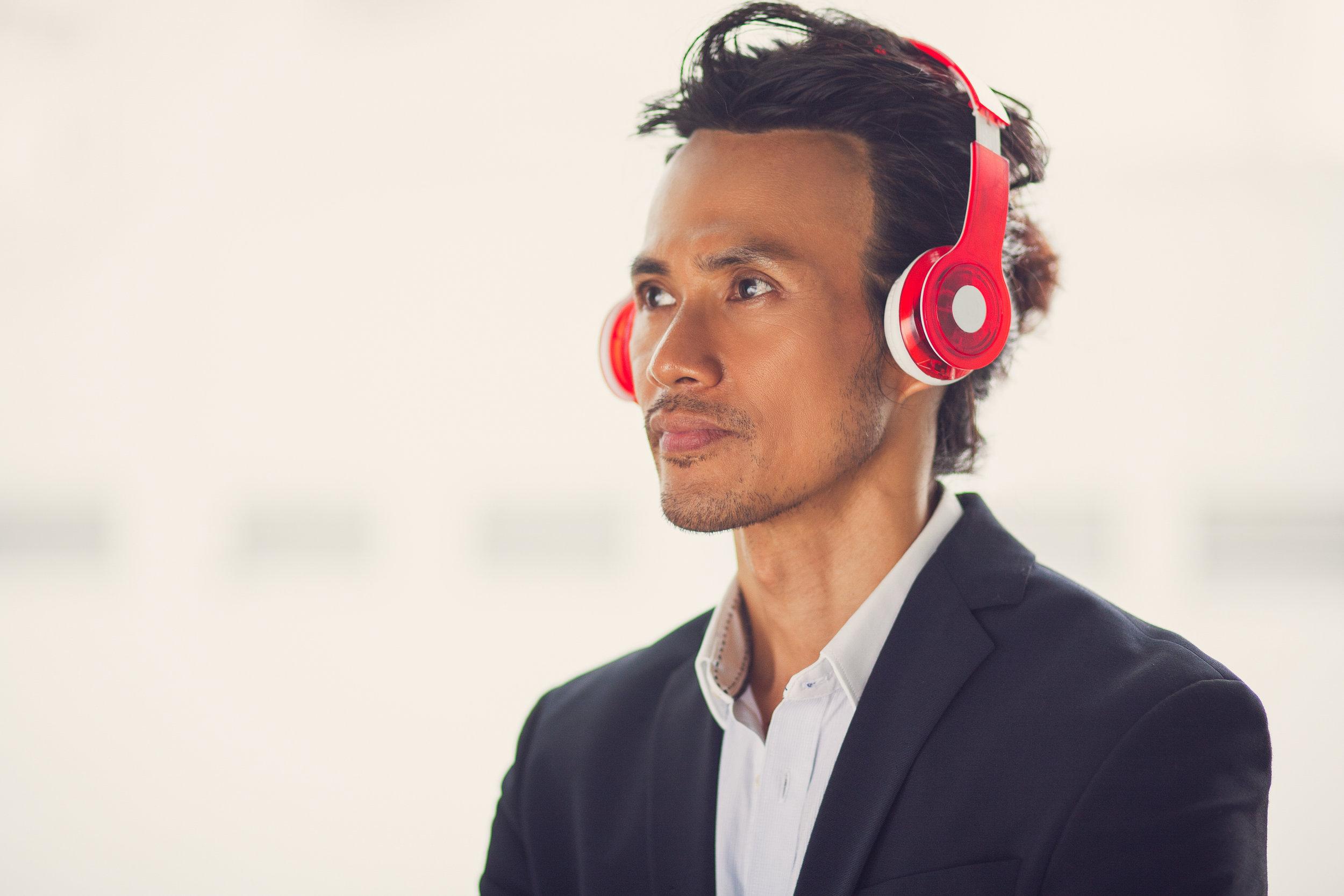 Man(Asian)_Listening_to_Headphones.jpeg