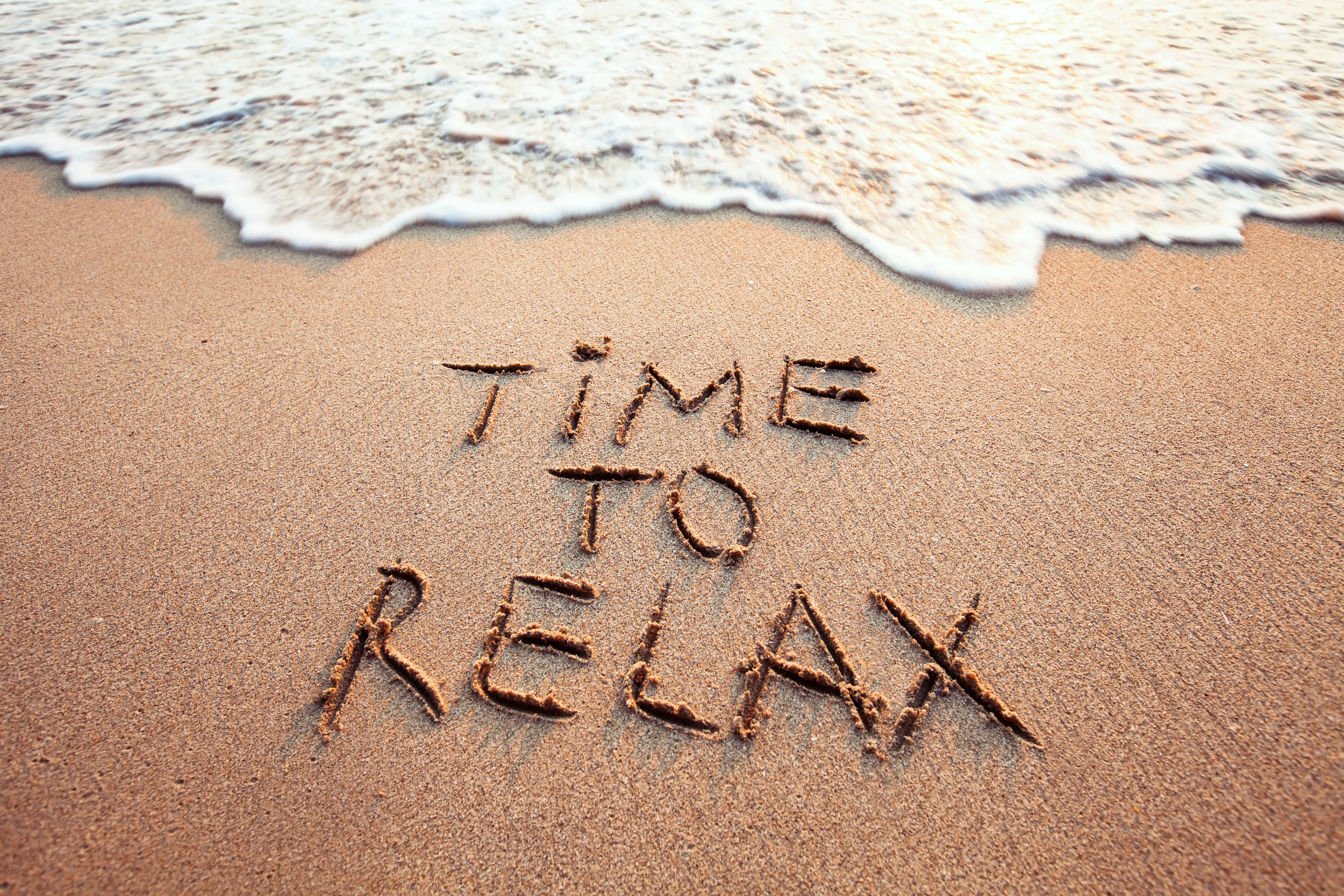 Beach-Message_in_Sand-Time_to_Relax.jpeg
