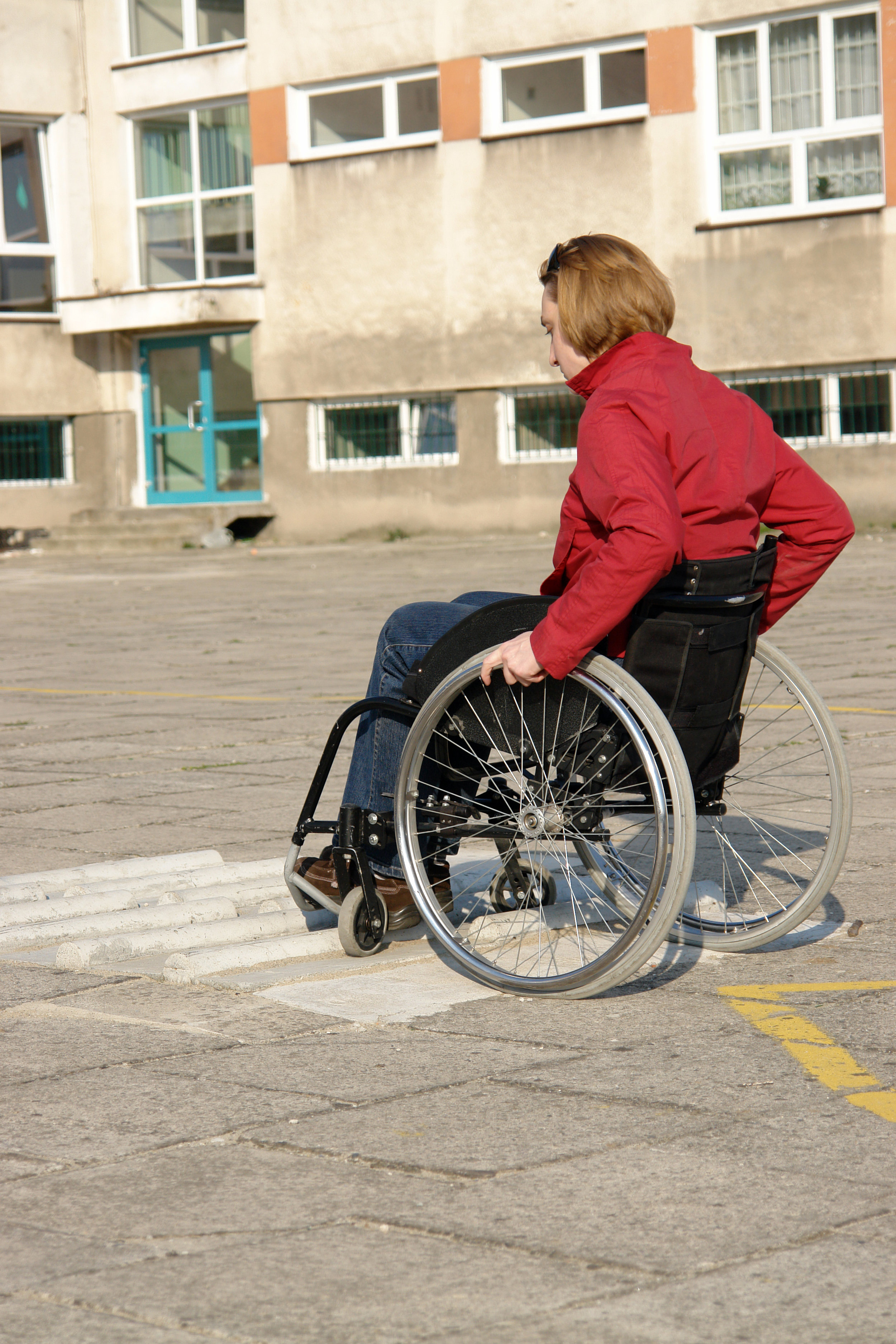 Wheelchair_Boy:Girl_in_Front_of_Building.jpeg