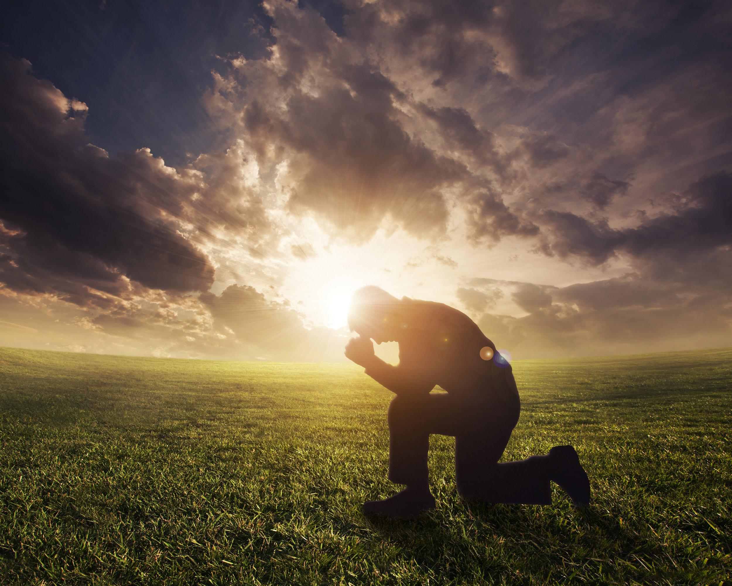 Kneeling_Man_at_Sunset.jpeg