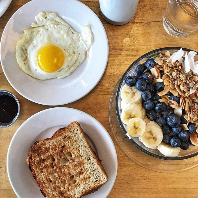 //My Breaky of Champions this AM! Chia seed Bowl with fruit, Sourdough Toast with an Egg 🍳 To me, Breakfast isn't the most important meal of the day— But today, THIS one was worth it. I love breakfast foods 😍 I normally fast until 11 or 12, sometimes later and always with intention. Your body is still using the food you had at dinner time for energy so you don't necessarily have to replenish right when you wake. (Except for water with lemon). But every BODY is made differently and everyone has to do what's right for their body. This also depends on your goals and needs if fasting is necessary or not. I started practicing intermittent fasting 4-ish years ago when i was competing and not knowing anything about it but what I realized was it helped me in multiple aspects to my health. (Weightloss, Stamina, Alertness, Digestion..to name a few!) and to date, i still continue to intermittent fast because my body works much more efficiently and effectively. Always do your research and talk to your nutritionist about what's best for you! . . . #wakeywakey #eggsnbakey #breakfastideas #breakfast #chiaseedpudding #fruit #intermittentfasting #toast #november #mondaymorning #enjoyfood #foodie #foodphotography #foodporn #sunnysideup #healthymeal #eatwell #eatbalanced #foodoftheday #foodofinstagram #cookinglightmagazine