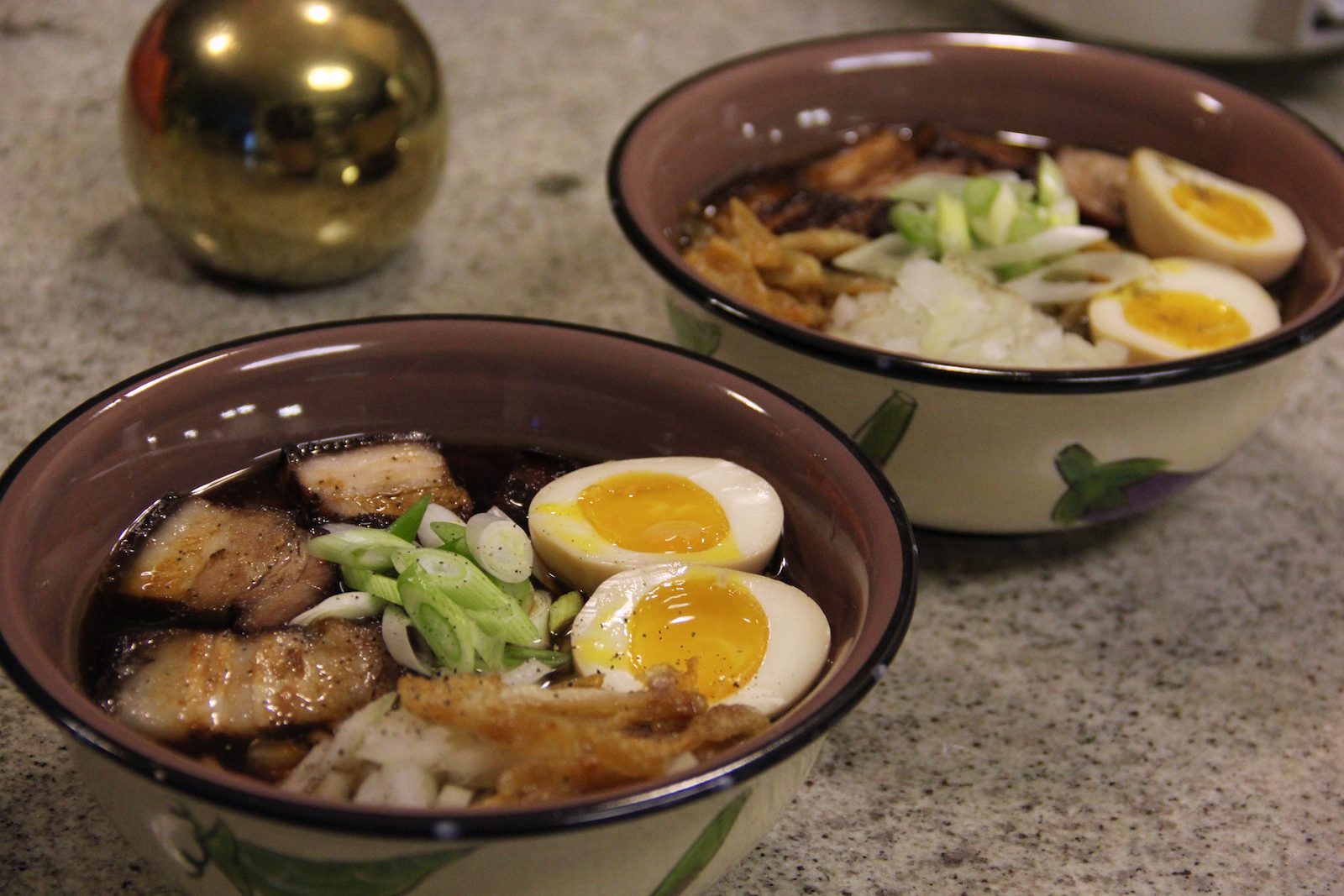 Our painstakingly made ramen! Toppings are marinated pork belly cooked for a million years, fried chicken skin + oil, ajitama, onions, green onions, and a dash of pepper! Was super delicious but would I do the whole process again? Unclear.