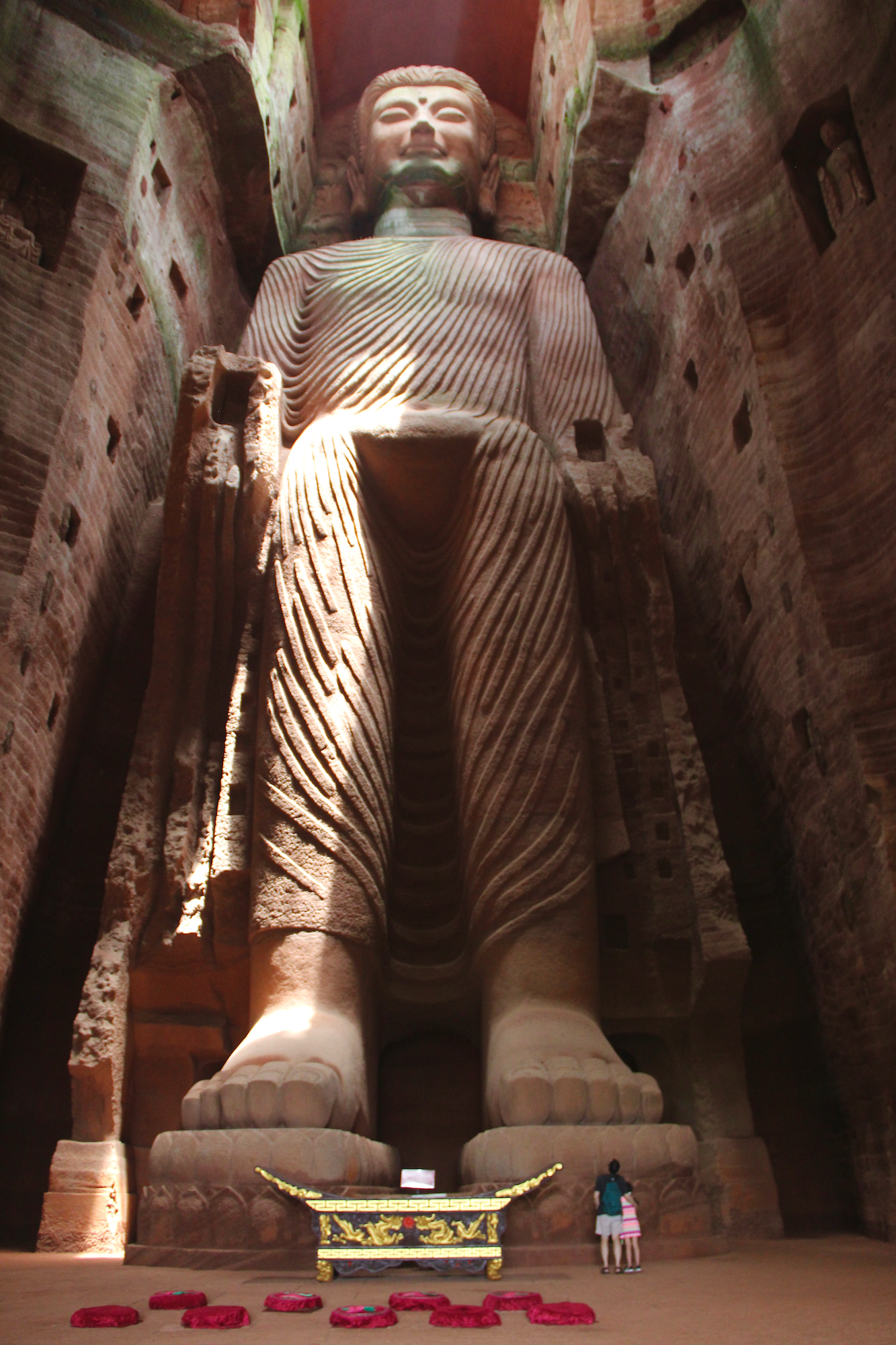 This is actually not the Leshan Giant Buddha - that one is as tall as the mountain and impossible to photograph. This one is carved inside the mountain. Loved the size comparison of this one vs. my dad and sister standing at the feet.