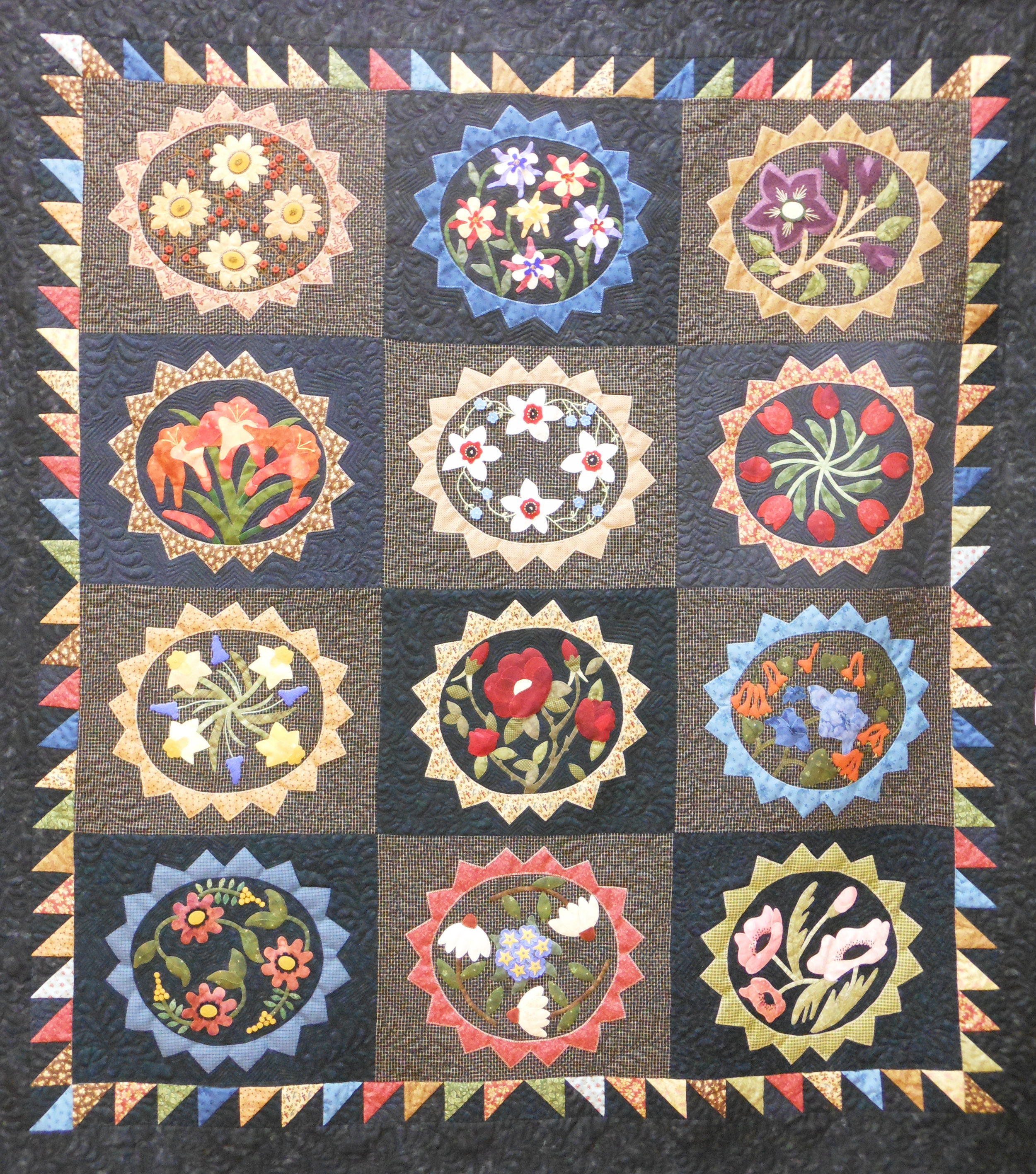 Hand applique-flowers and feathers.jpg