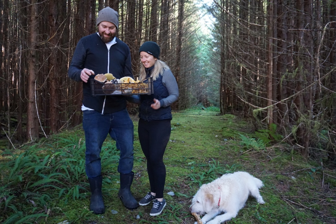 Foraging with Wolf in the Fog chef Nick Nutting and bar manager Hailey Pasemko, and their dog, Oscar.