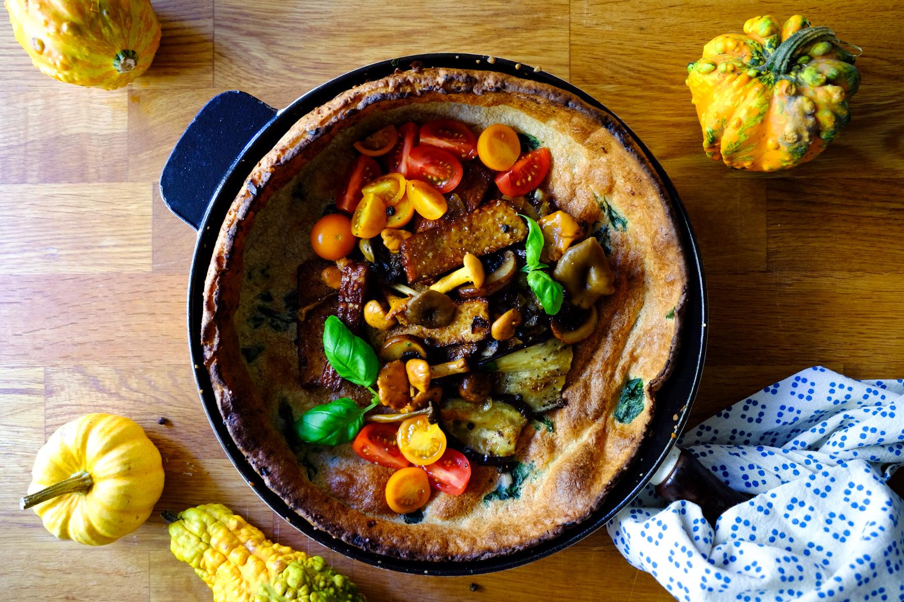 Savoury Dutch Baby Pancake  with foraged mushrooms, tofu, and cherry tomatoes  © Menzi Mhlanga