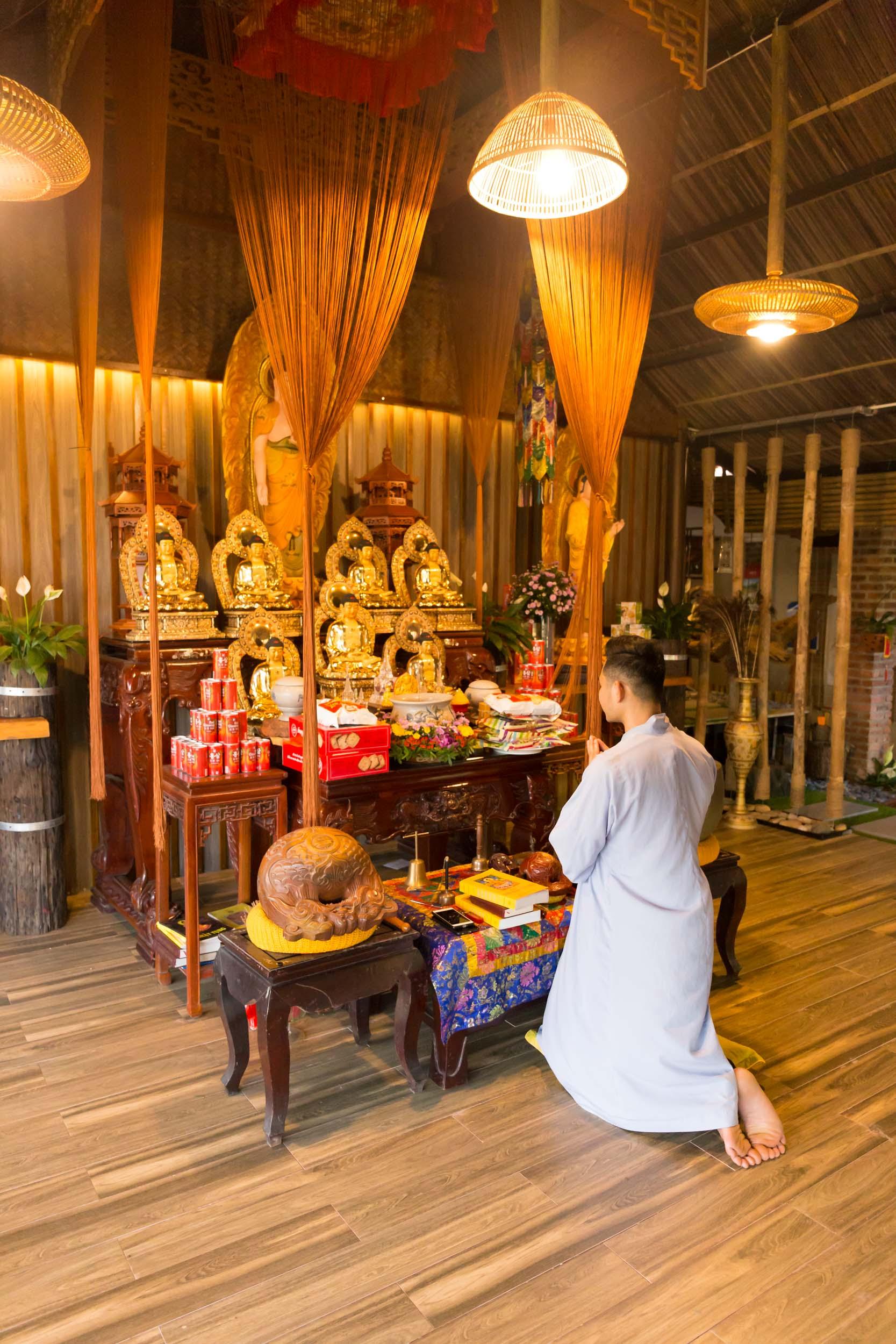 Praying on the Marble Mountain, Da Nang, Vietnam.