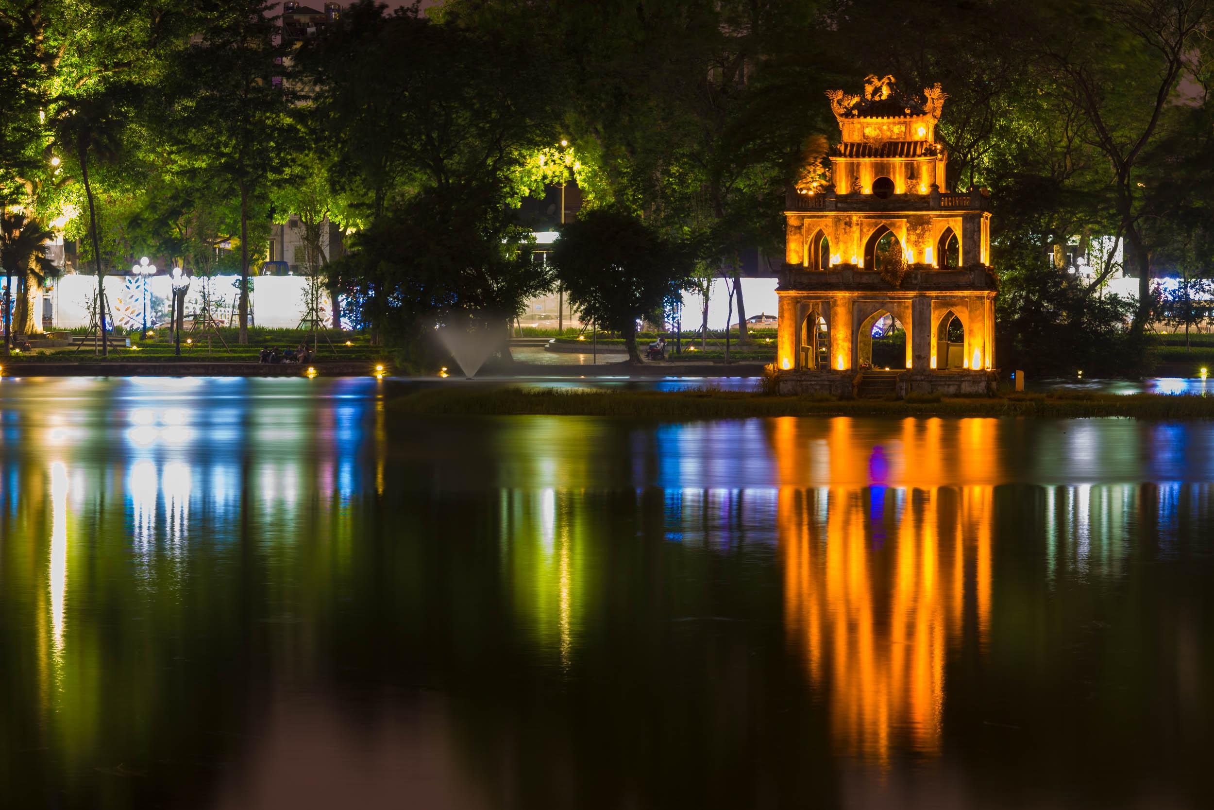 Night shot of monument on Ho Hoan Kiem Lake Hanoi, Vietnam.