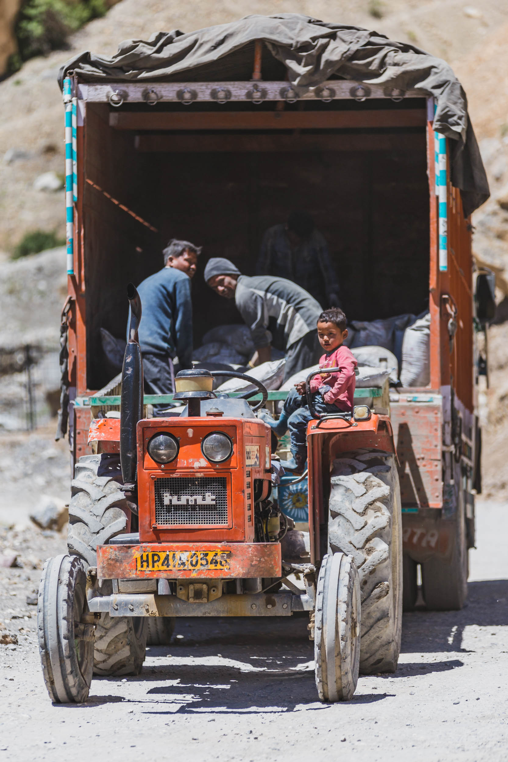Locals working on tractor in Kaza, Spiti Valley.