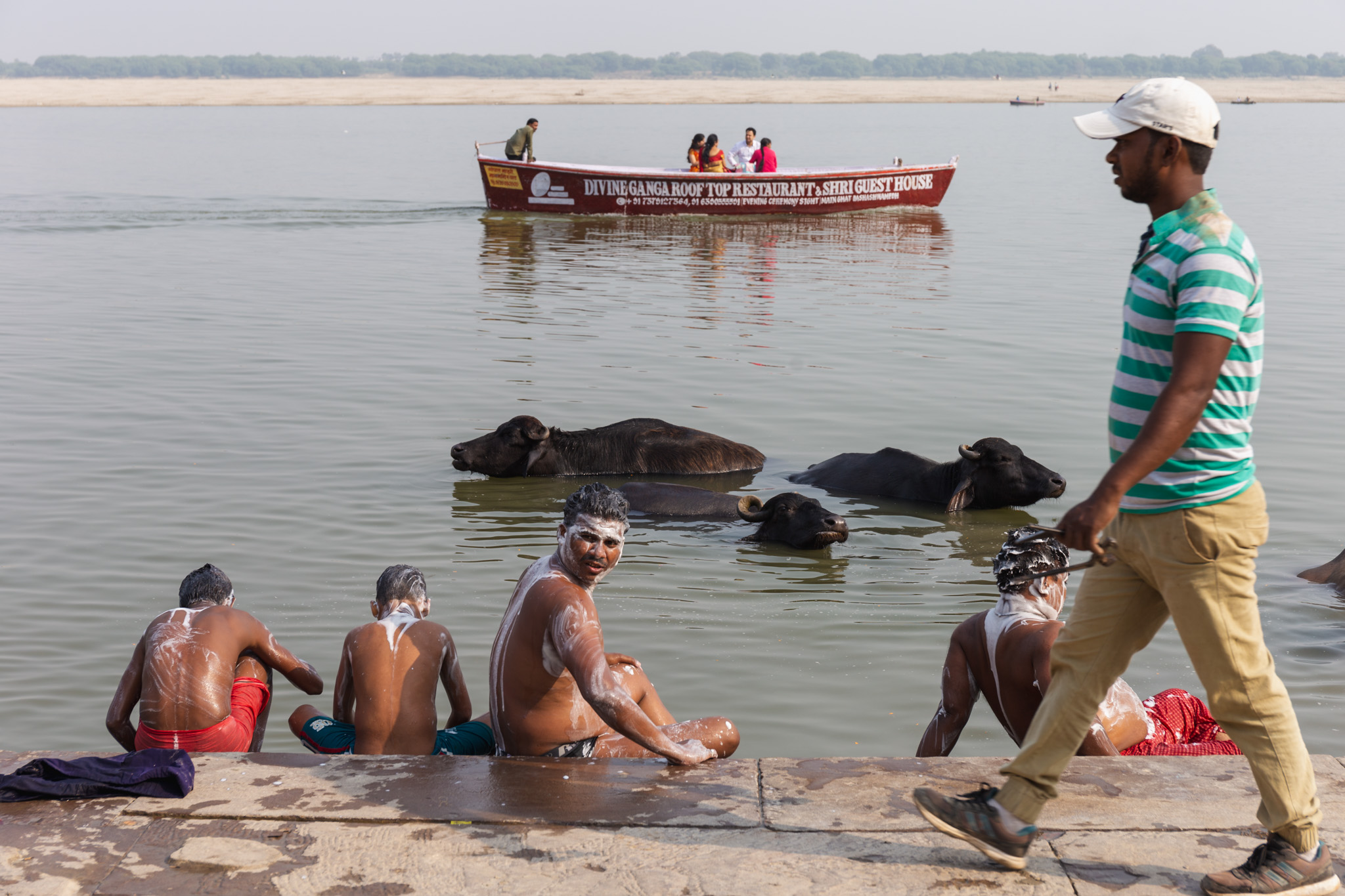 Group of locals wash in River Ganges.