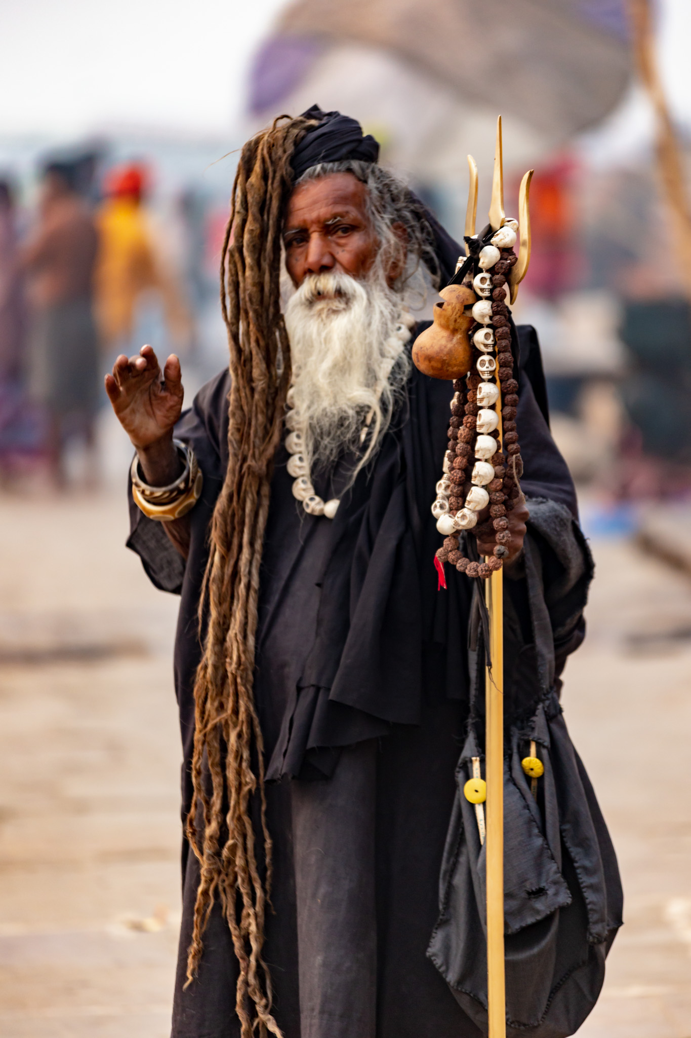 Indian Sadhu in full costume with staff.