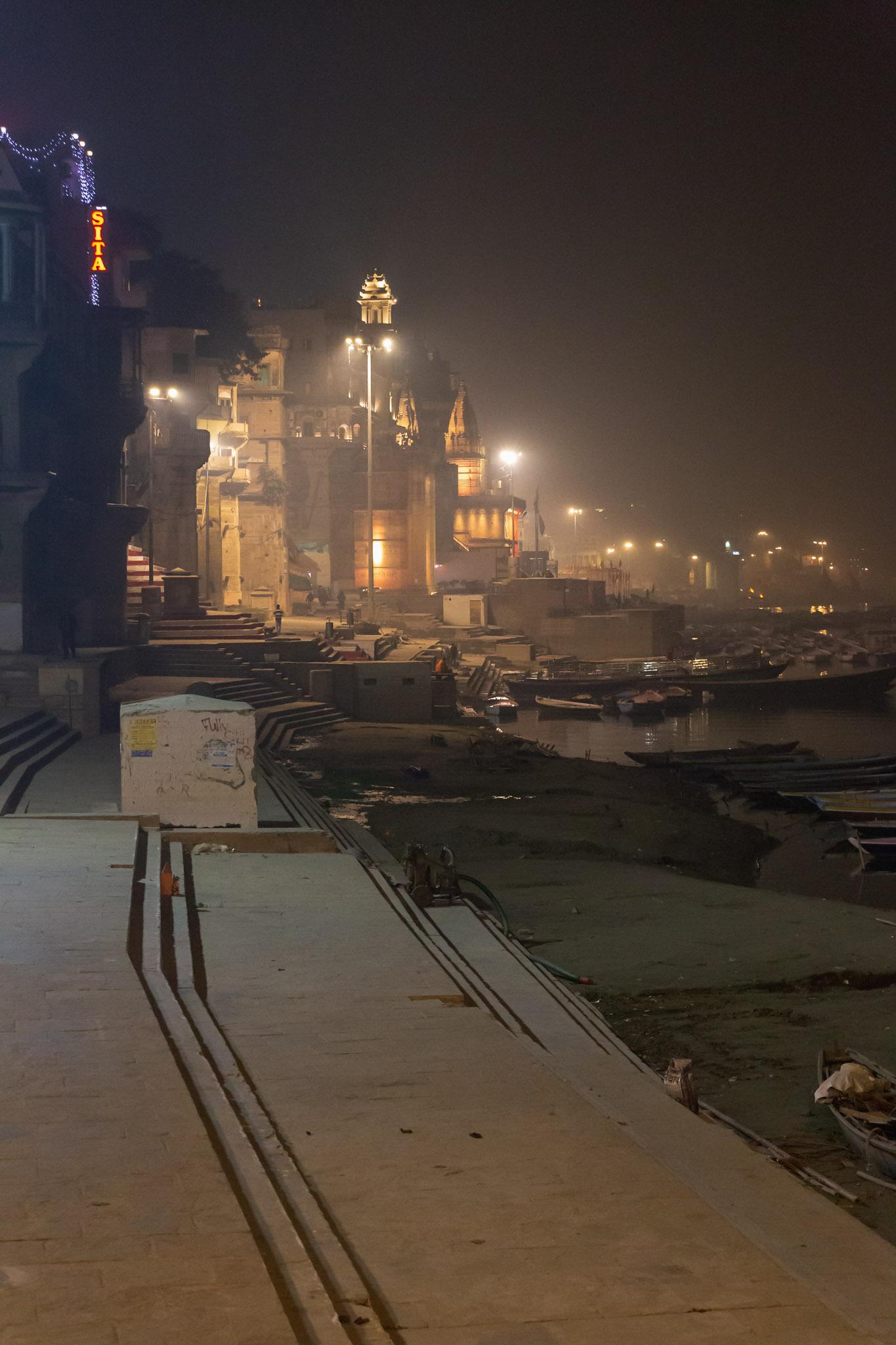 Night photo of Varanasi's misty river front.