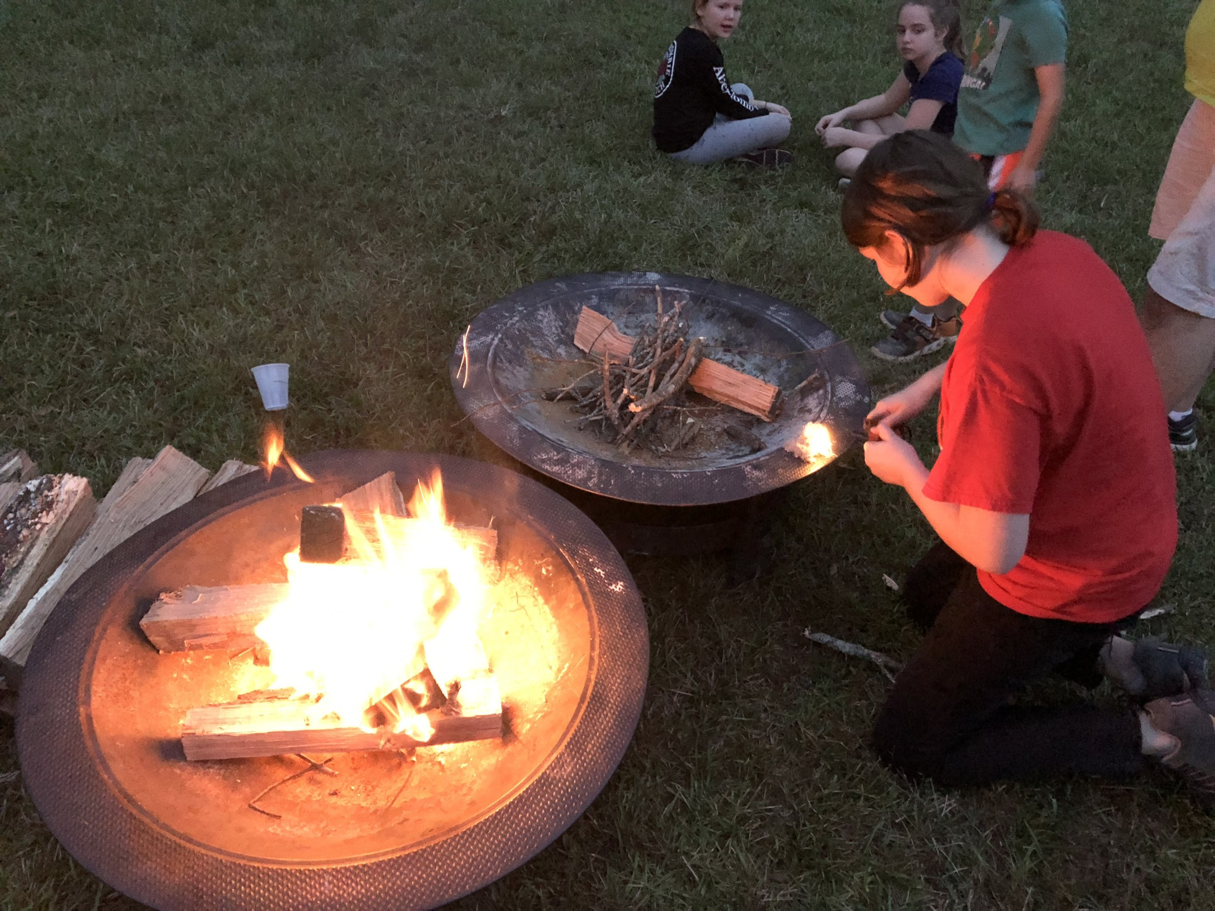 A Scouts BSA scout demonstrating how to start a fire