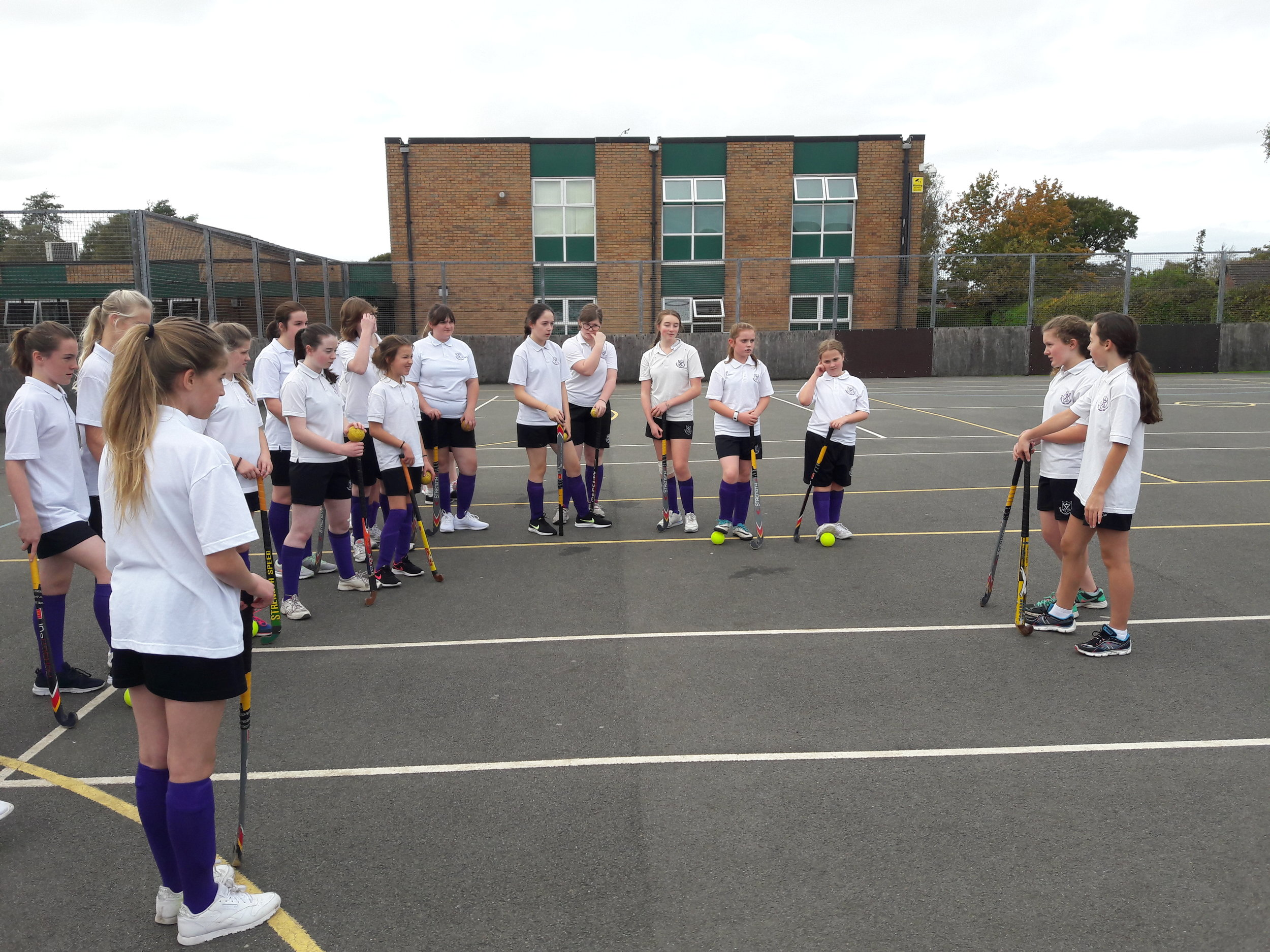 Chloe and Carmen, YR8, leading the warm-up