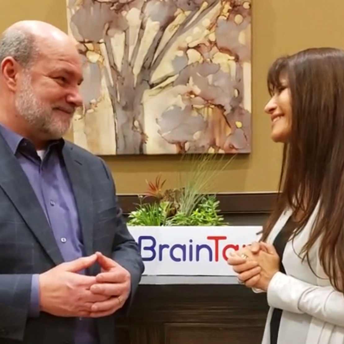 Dr. Patrick Porter, founder of BrainTap and Gaby de la Mora at the 2019  BrainTap Technology  Summit