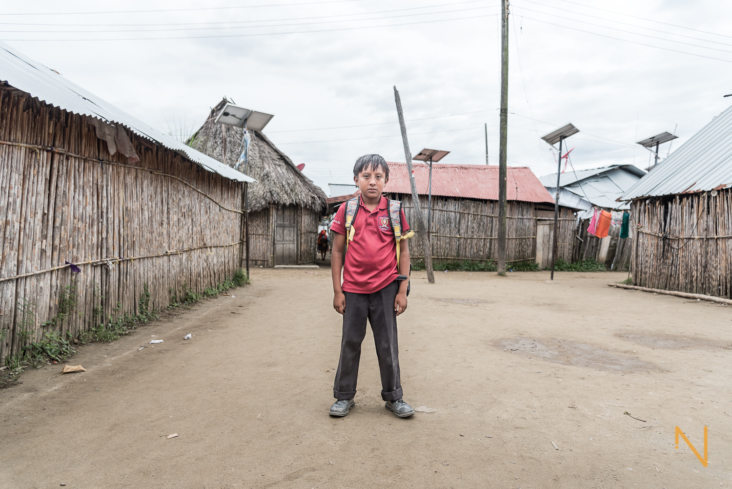 Juan Manuel, a boy of 11, before heading off to school.