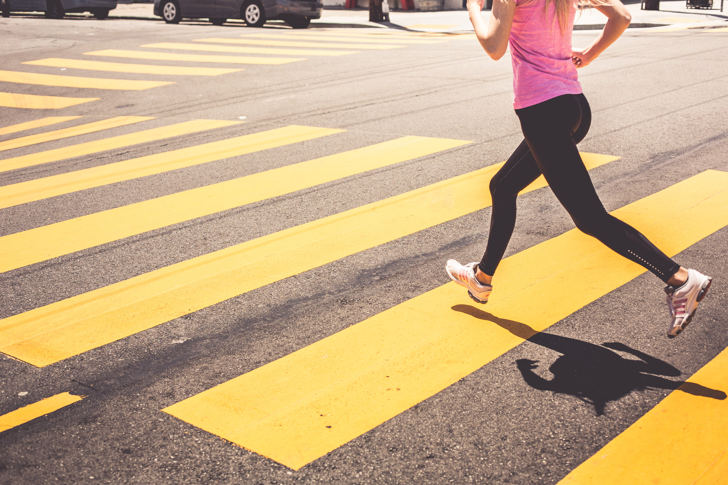 blonde-woman-running-over-the-pedestrian-crossing-picjumbo-com.jpg