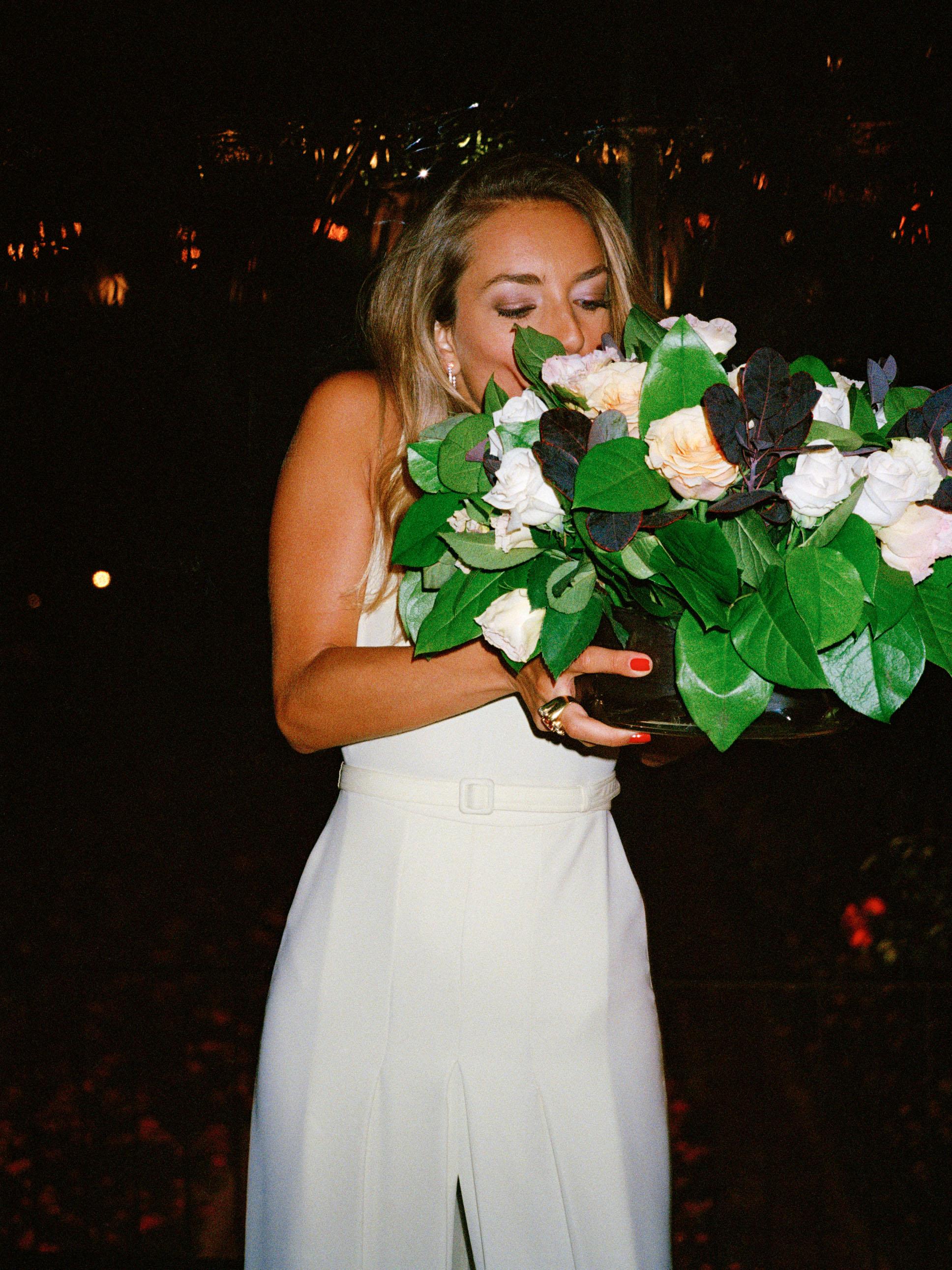 Melanie smelling flower