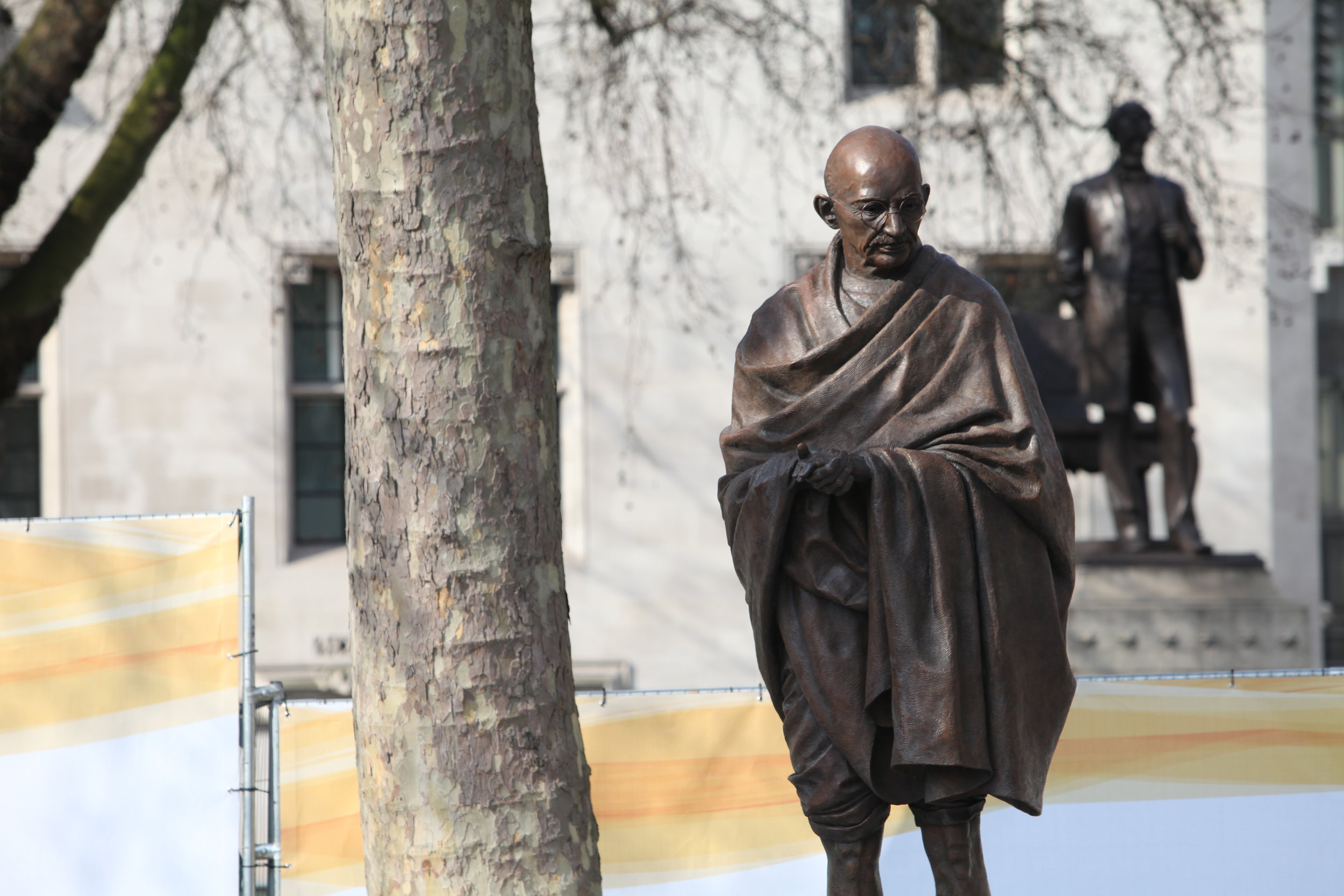 """Mohandas Karamchand Gandhi was one of the great idealists (and, I would make the case, Curious Idealists). Photo Credit: """"A statue of Gandhi is unveiled in Parliament Square in London, 14 March 2015"""" by Foreign and Commonwealth Office (Gandhi statue)."""