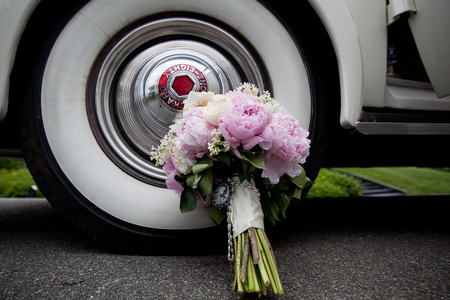 01.30.13+Packard+at+Farmington,+Looney+with+bouquet+on+tire.jpg