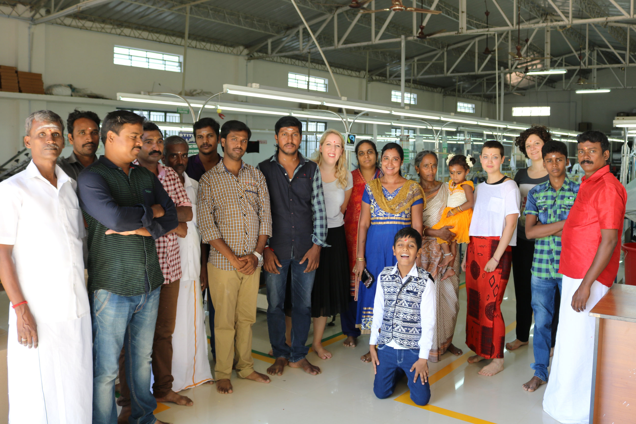 The dedicated and hardworking men and women behind KTO clothing pose with founder Charlotte Instone in their factory in South India.