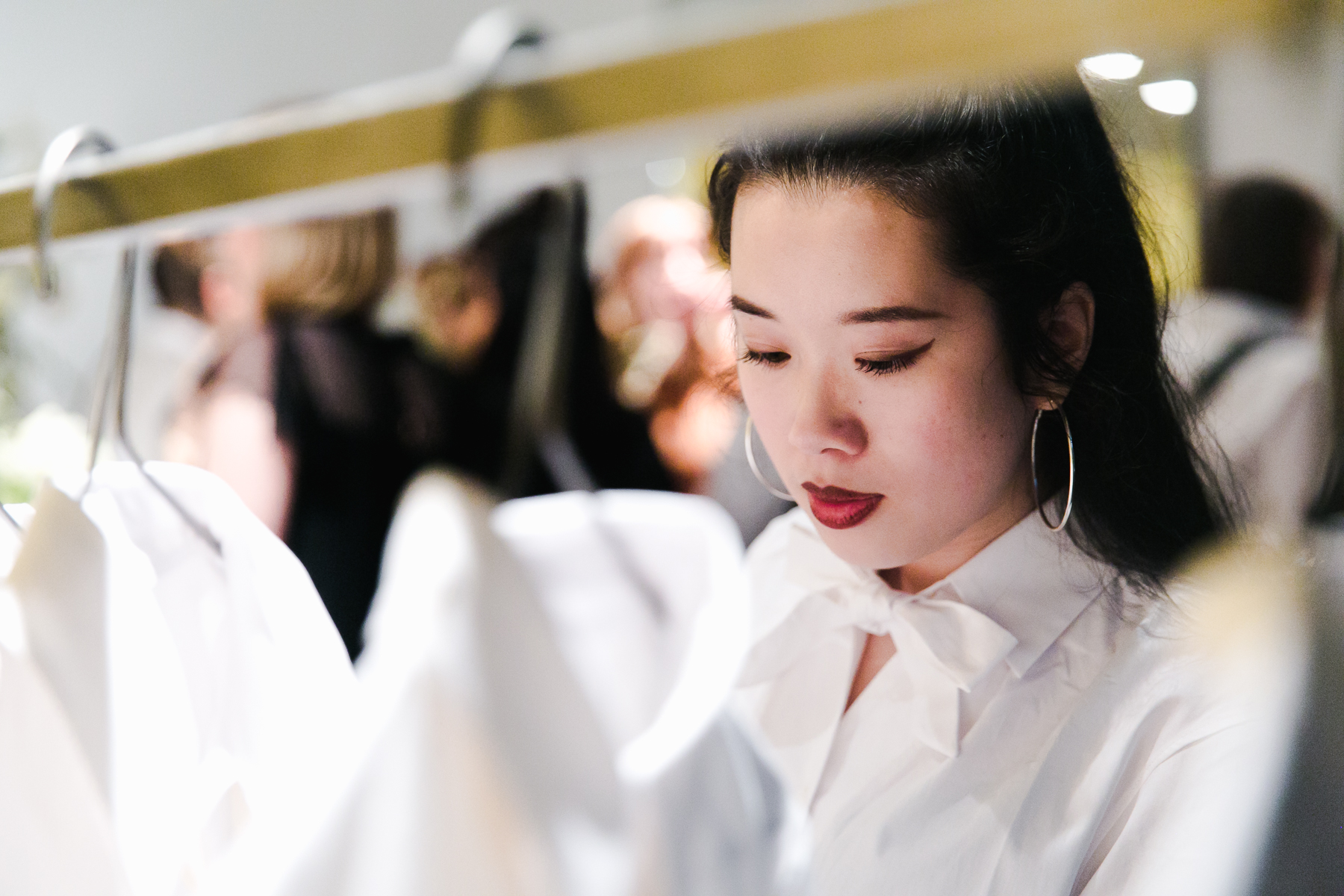 SUSTAIN Fashion Editor, Julia Le, wearing  The Preposition Shirt while viewing the collection.