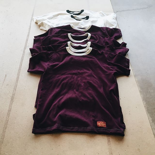 """ Black on Cream Detroit Tees "" and "" Cream on Maroon Detroit Tees "". (Photo courtesy of  Josh York )"