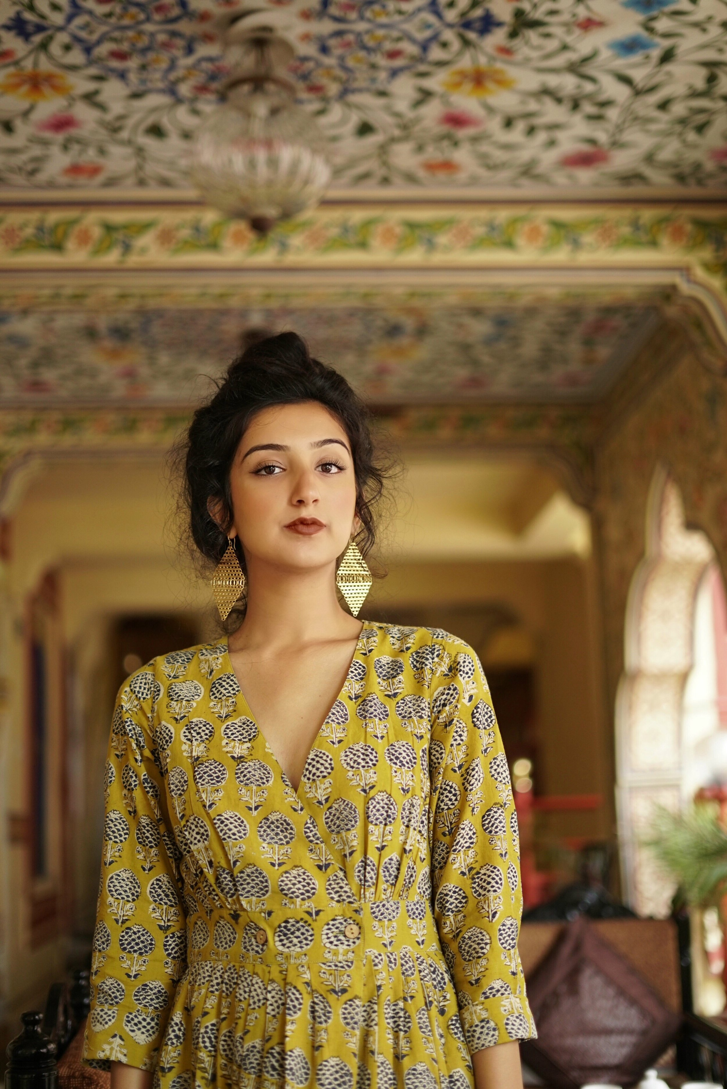 Mayer in Jaipur, India wearing  Inde Rooh  and earrings from  Anoma .
