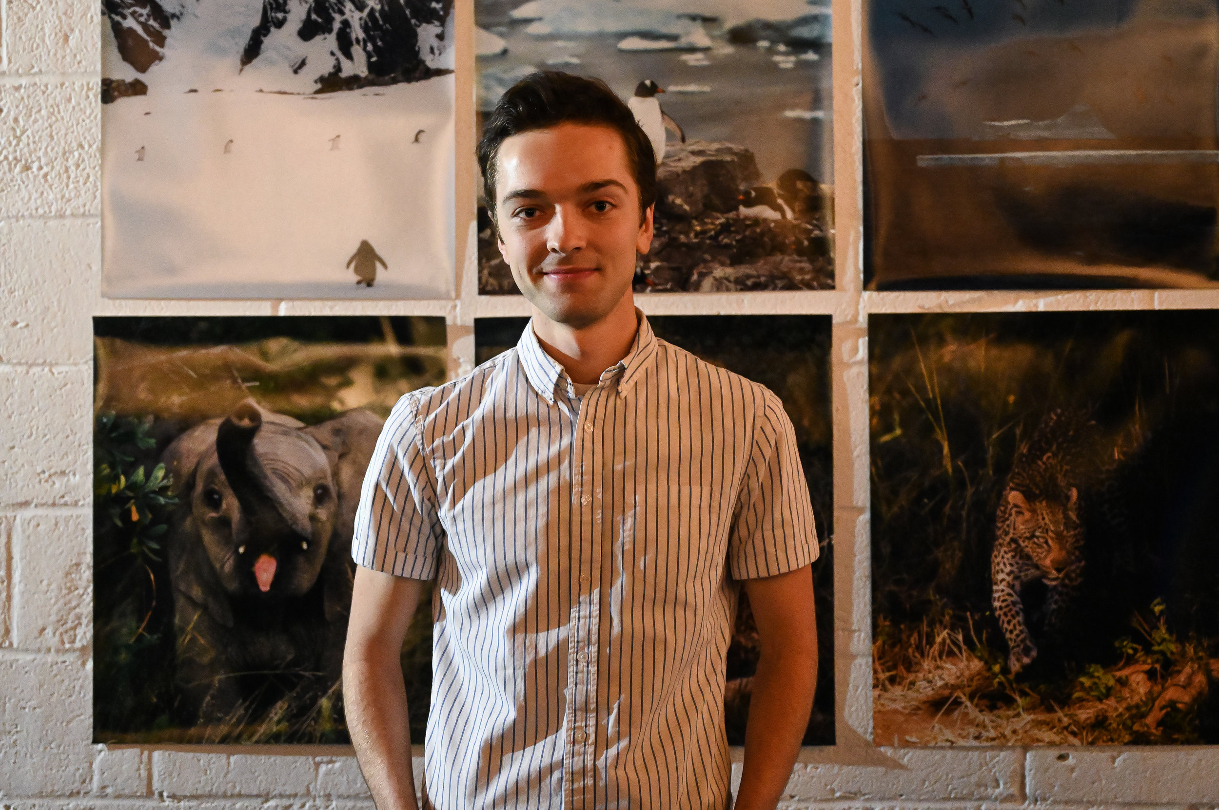 Joe Thomas in front of his photography.