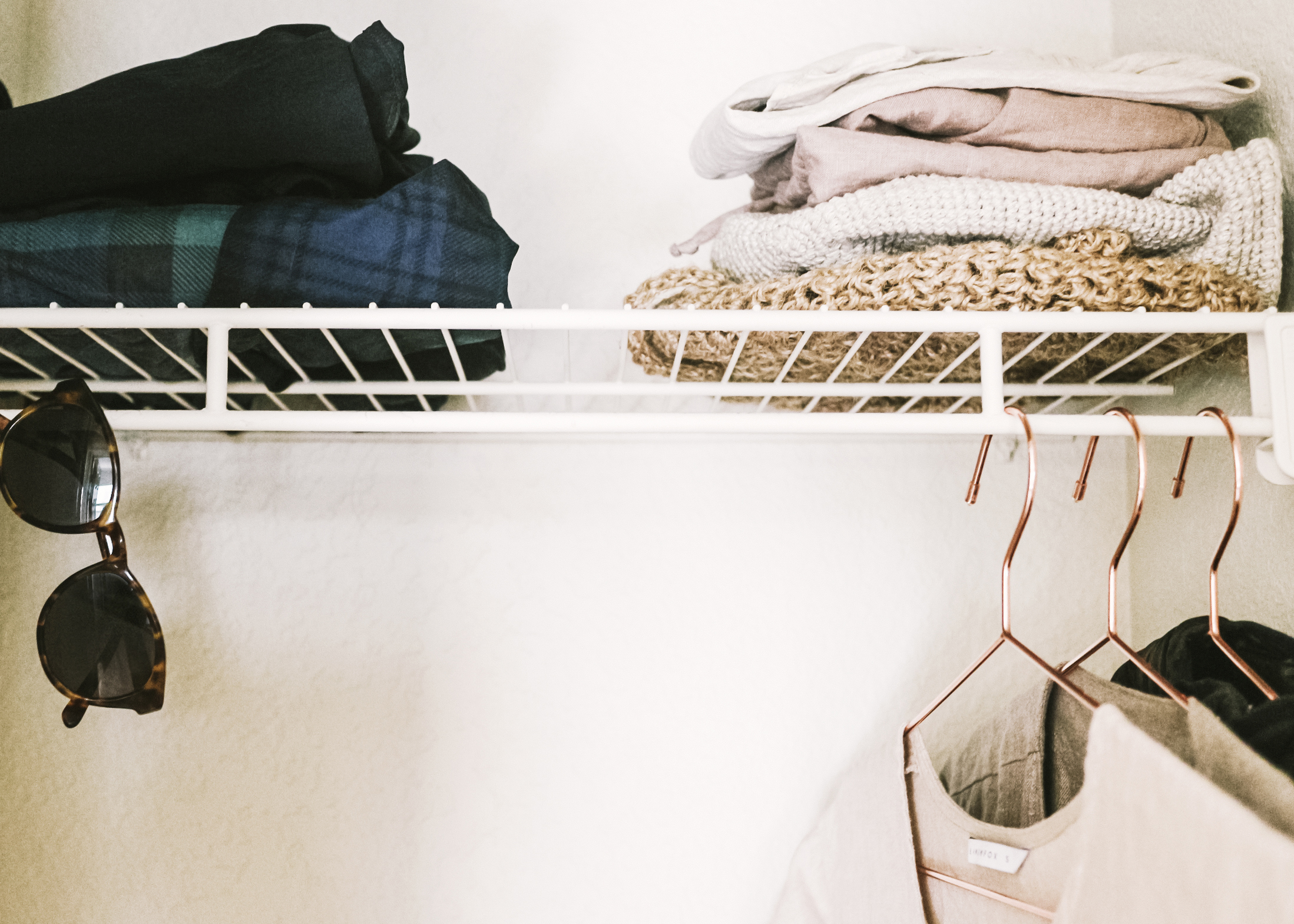 Simple and minimal closet by  Heal Your Living.